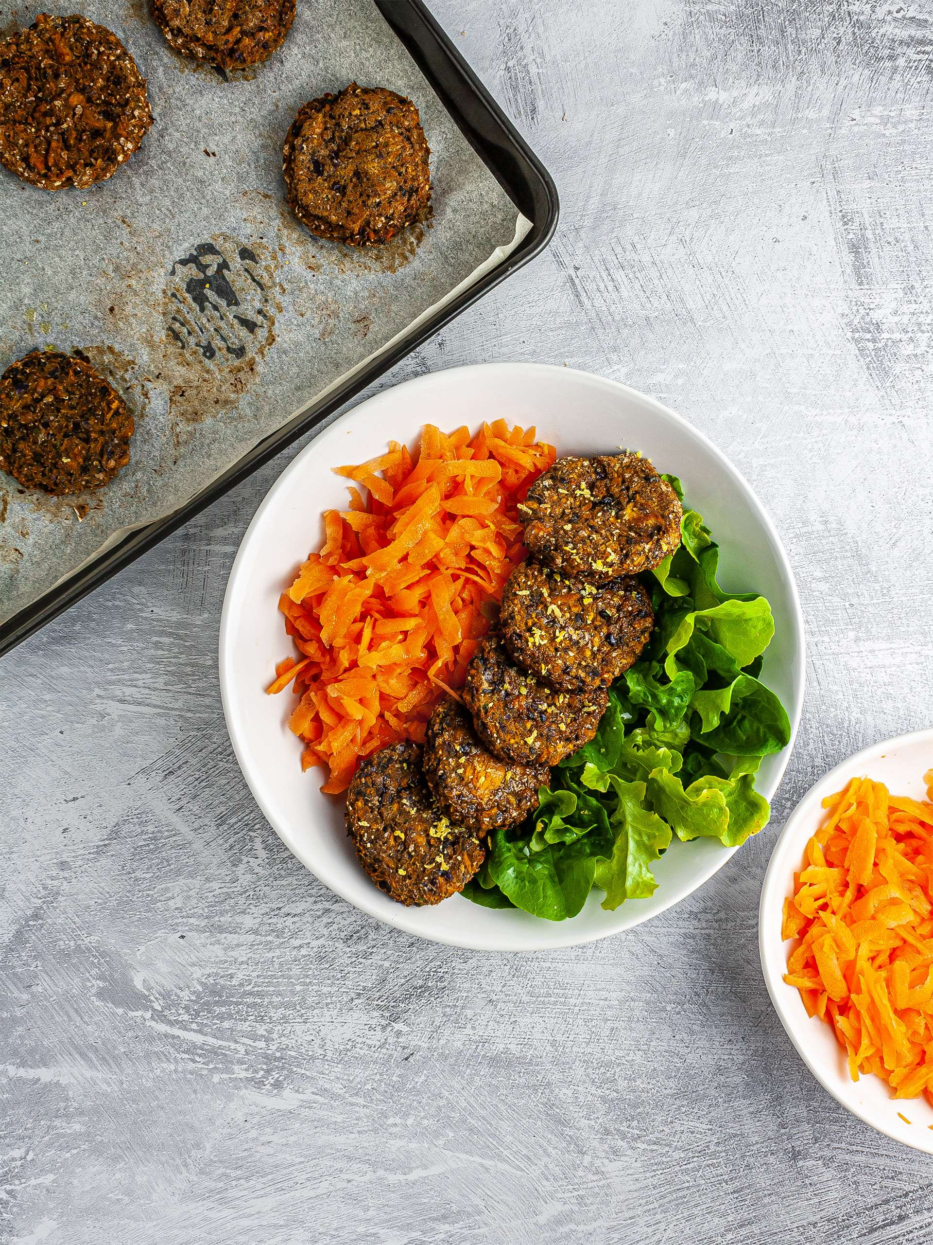 Baked falafels served with carrots and lettuce