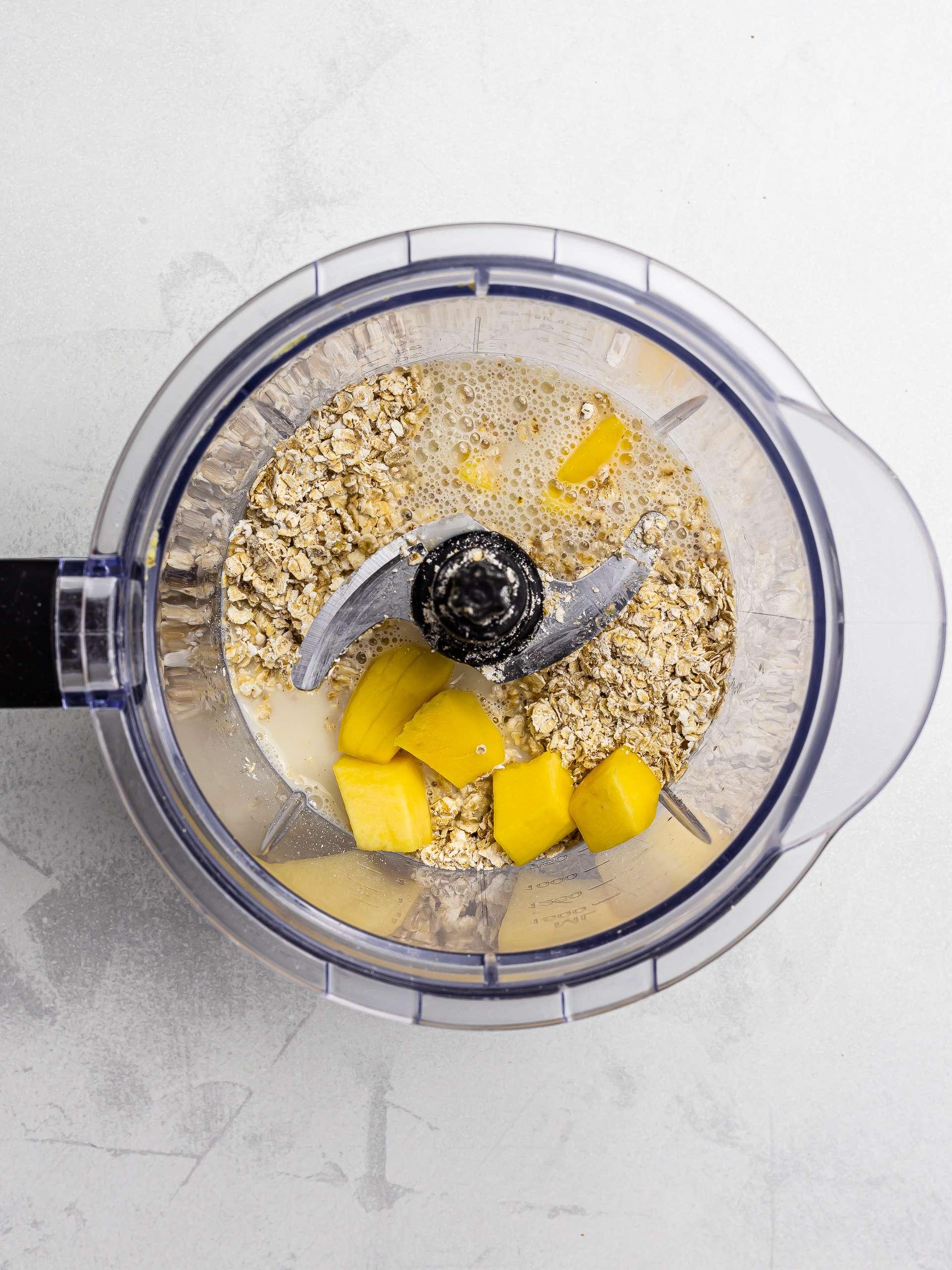 mango, oats, and oat milk in a blender