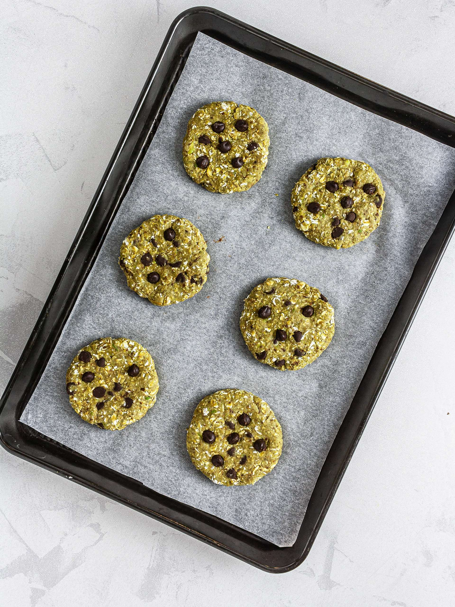 Shaped matcha chocolate chip cookies on a tray