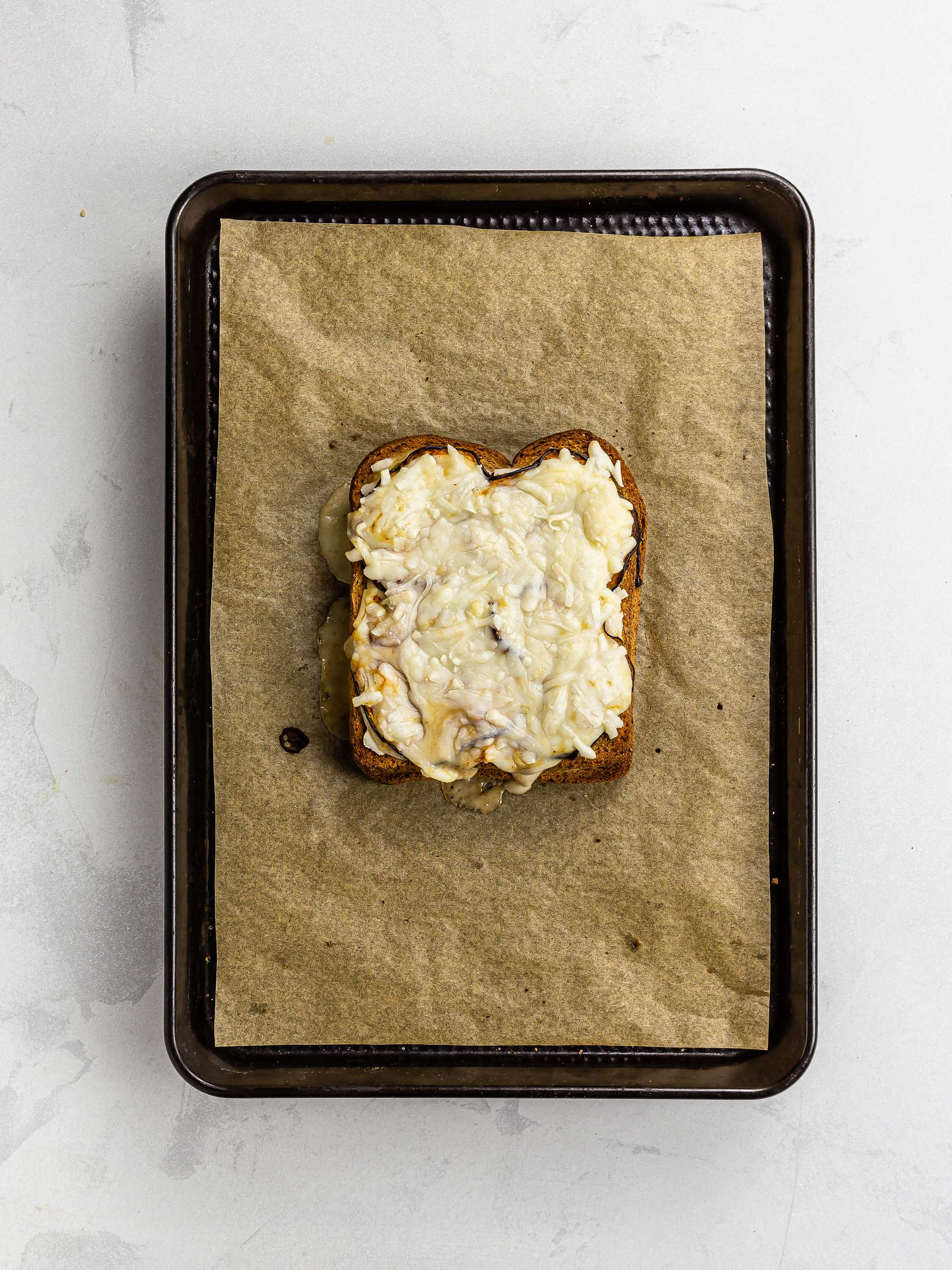 oven-baked vegan croque monsieur on a tray