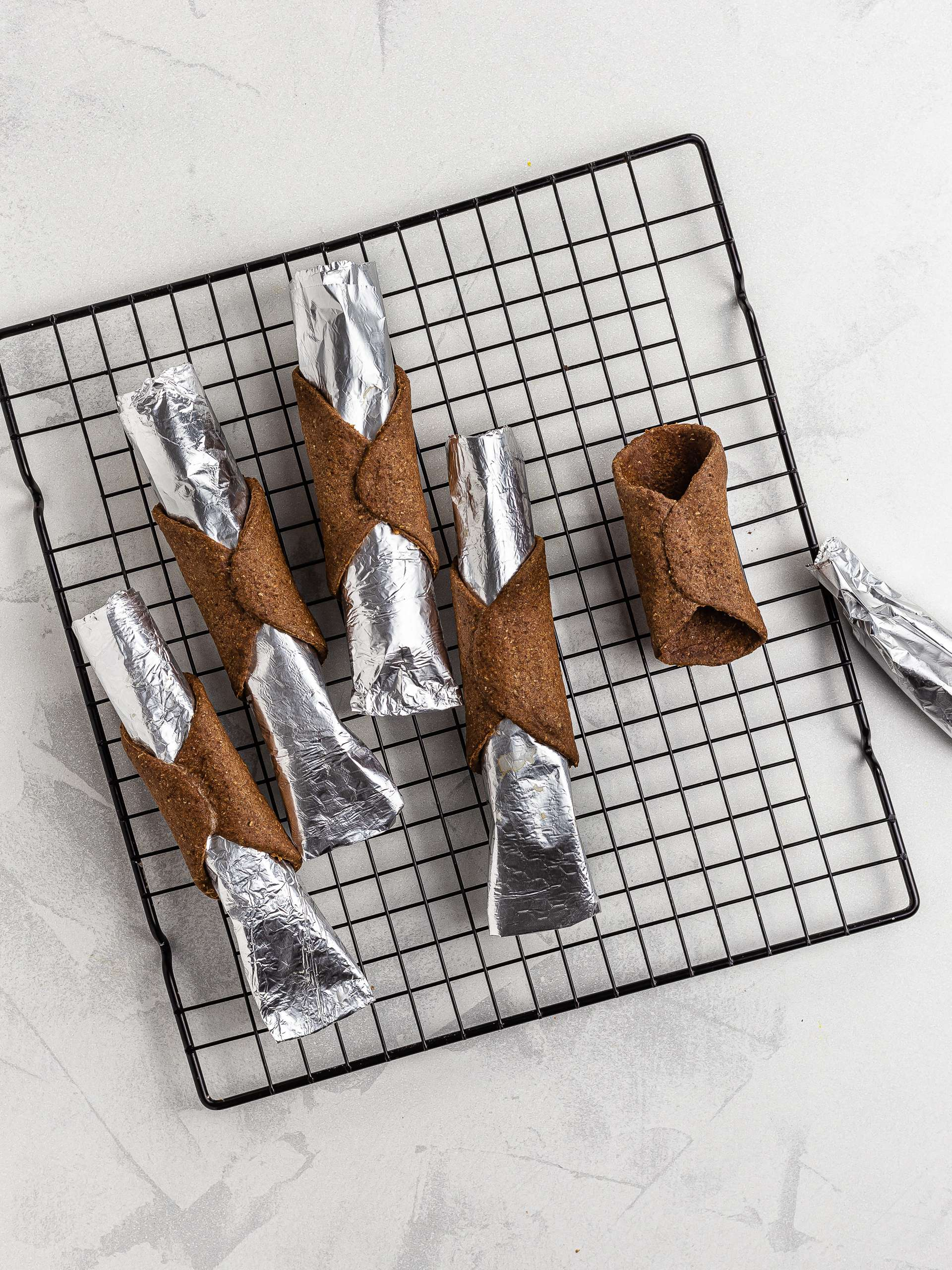 oven-baked vegan cannoli shells cooling on a wire rack
