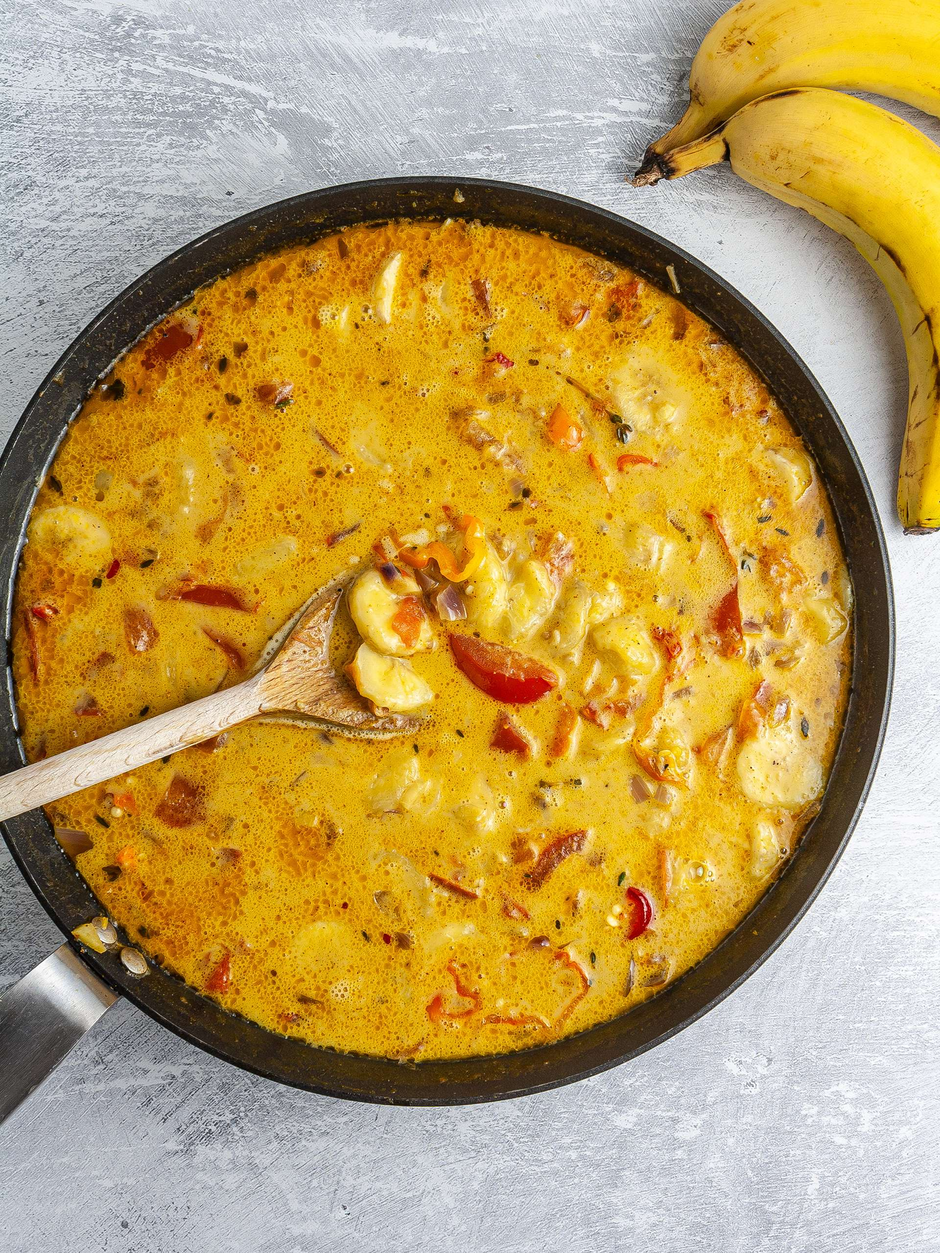 Sliced bananas added to the coconut curry