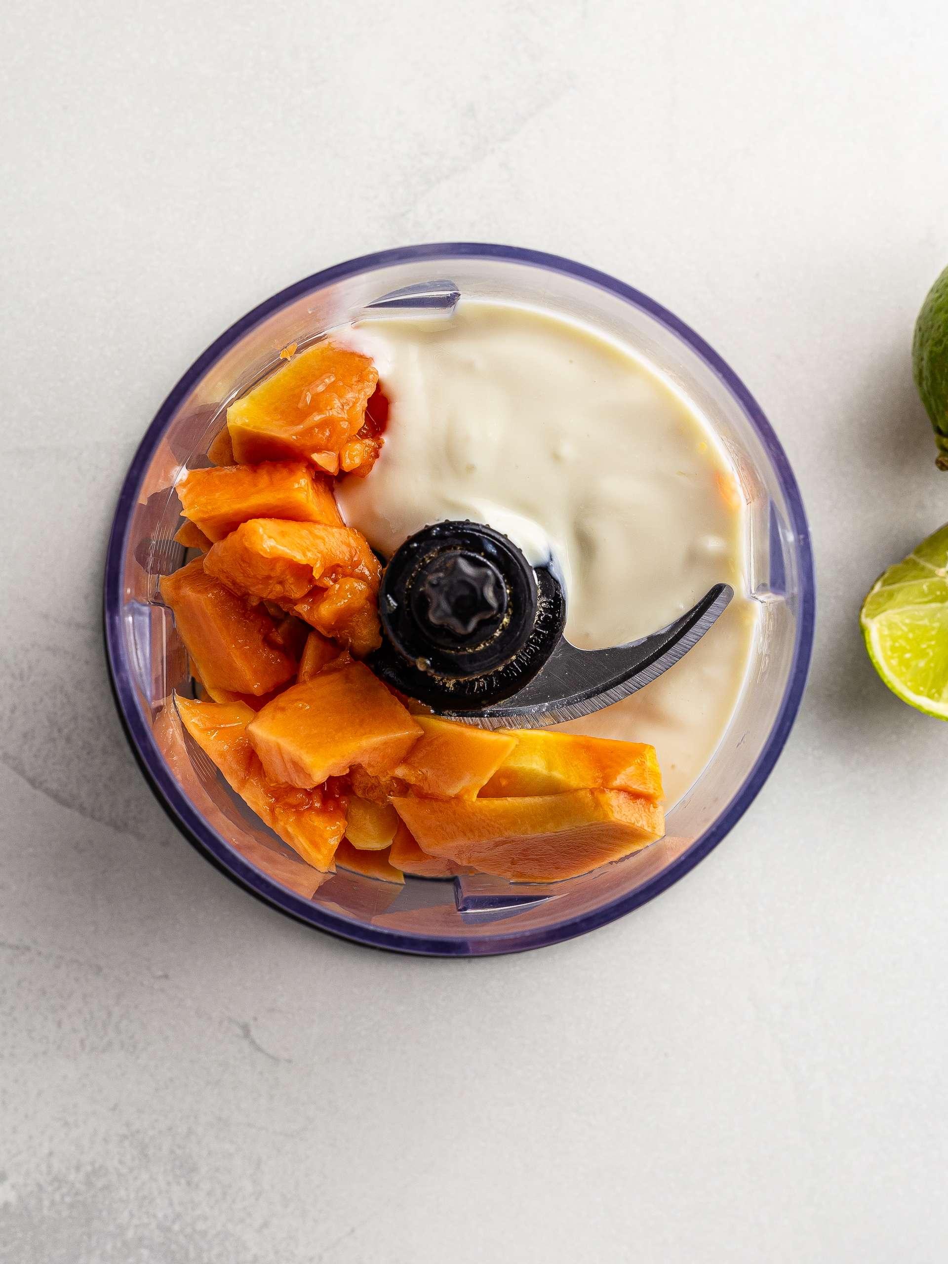 papaya yogurt and lime juice in a blender
