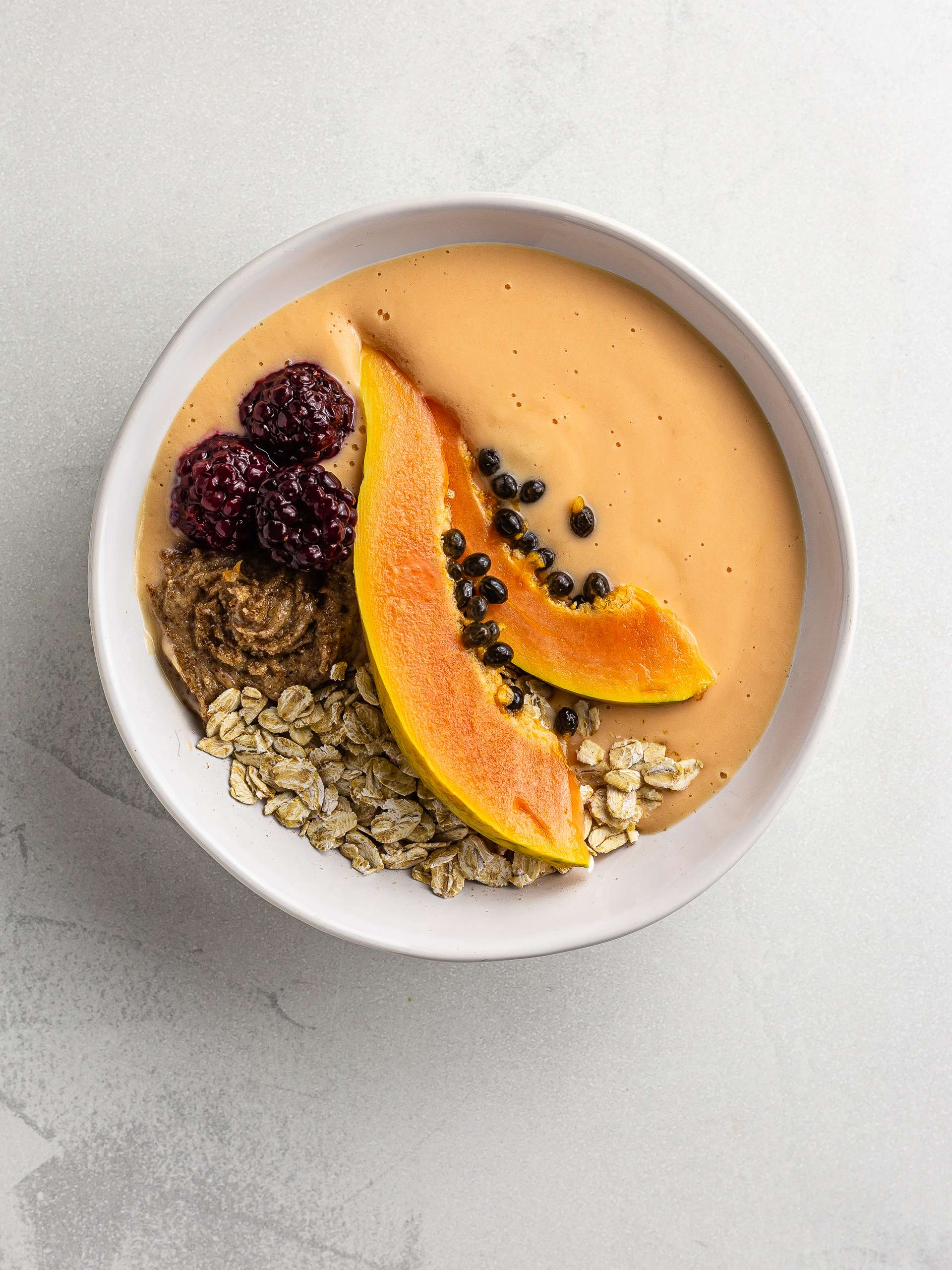 papaya smoothie bowl with oats and blackberries
