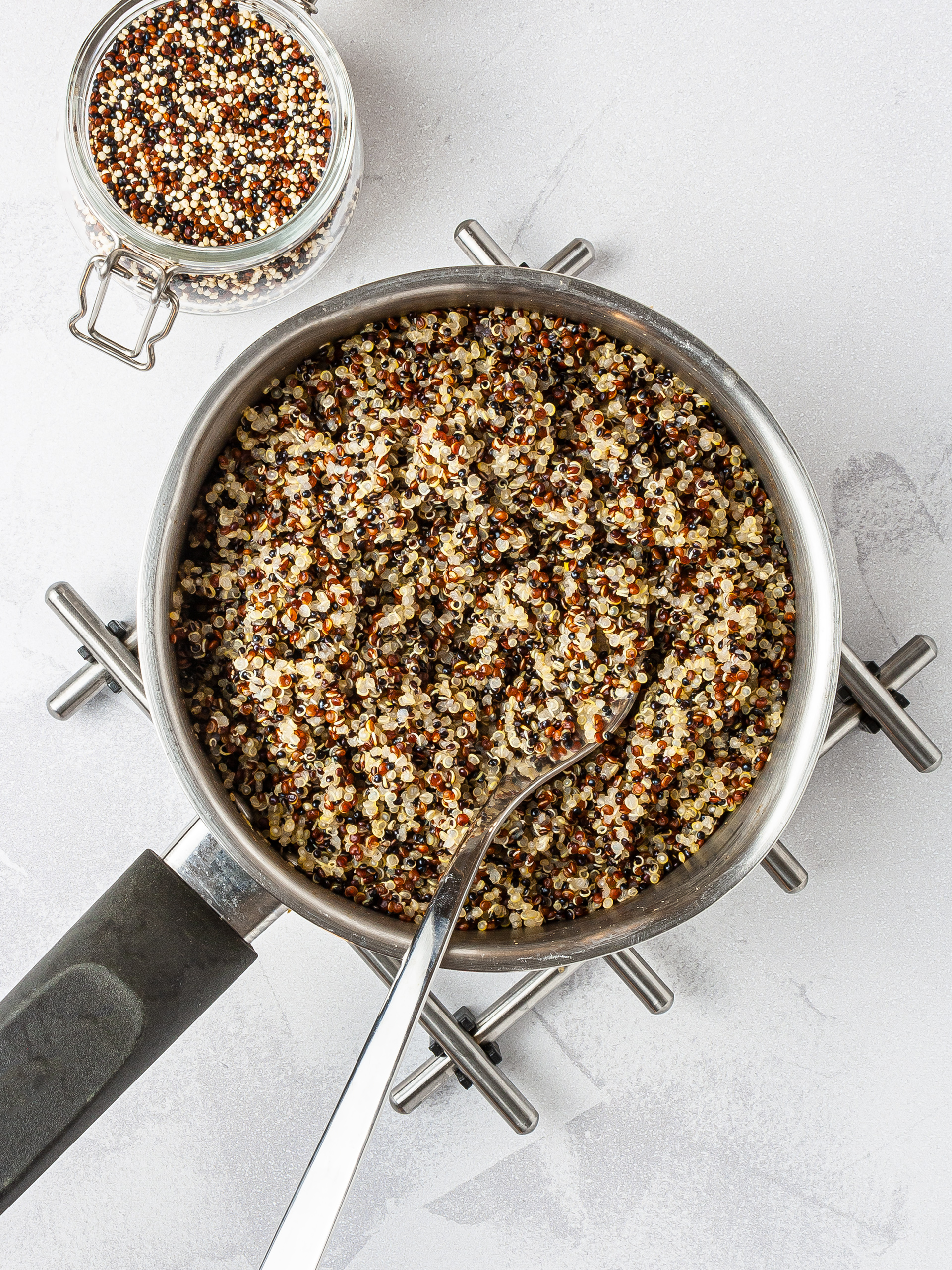 Cooked quinoa in a pan.