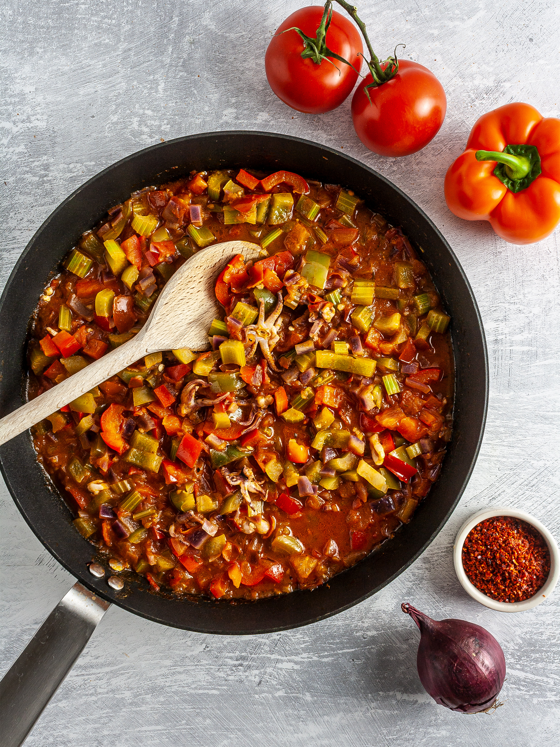 Cooked tomatoes, pepper, onions, and celery in a skillet