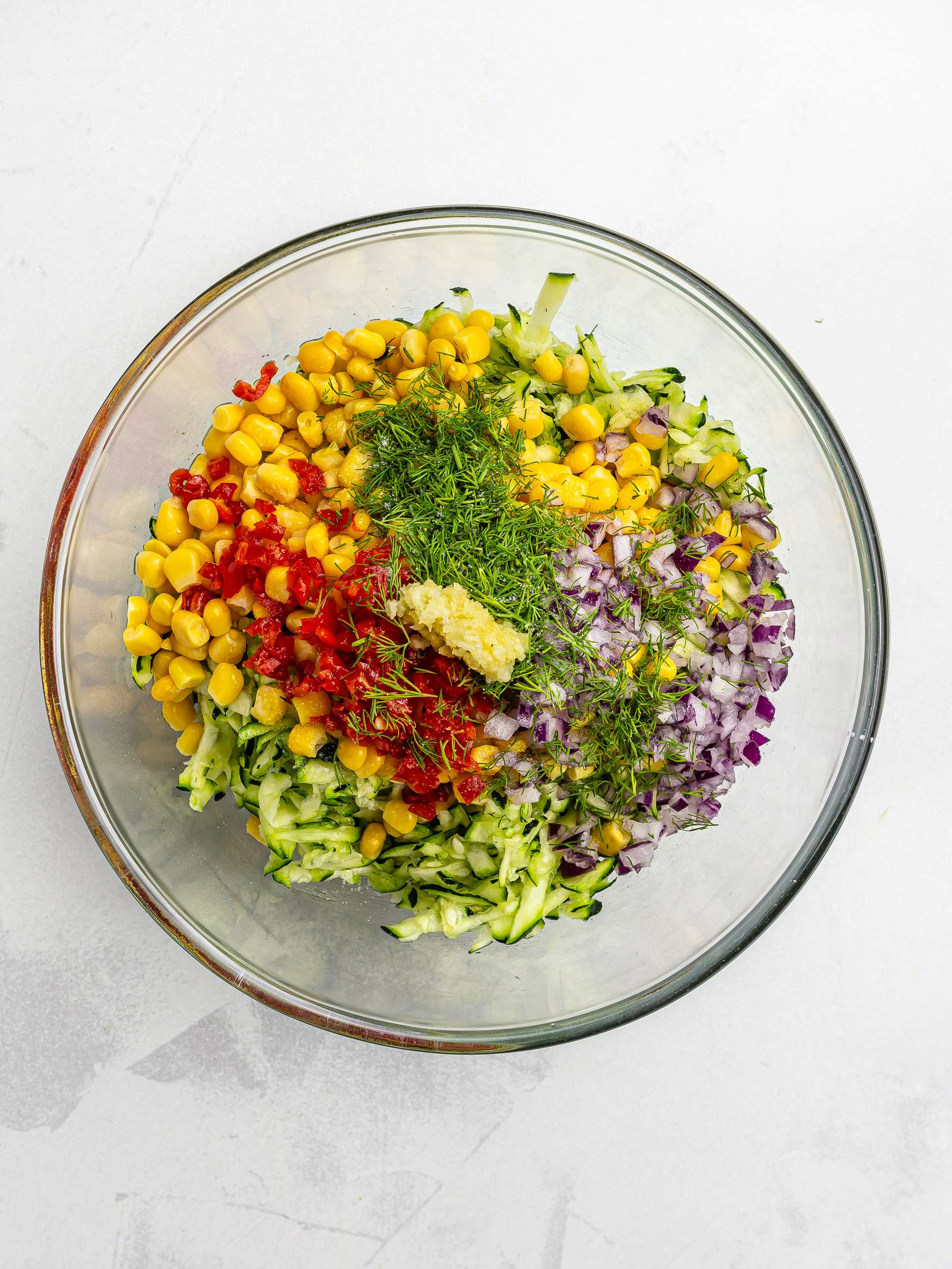 courgette and corn fritters ingredients in a bowl
