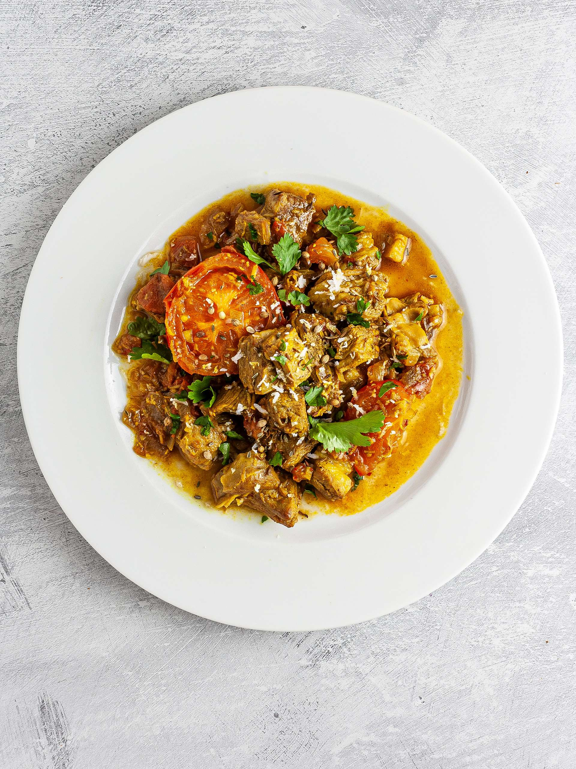 Lamb chettinad served with coconut and coriander