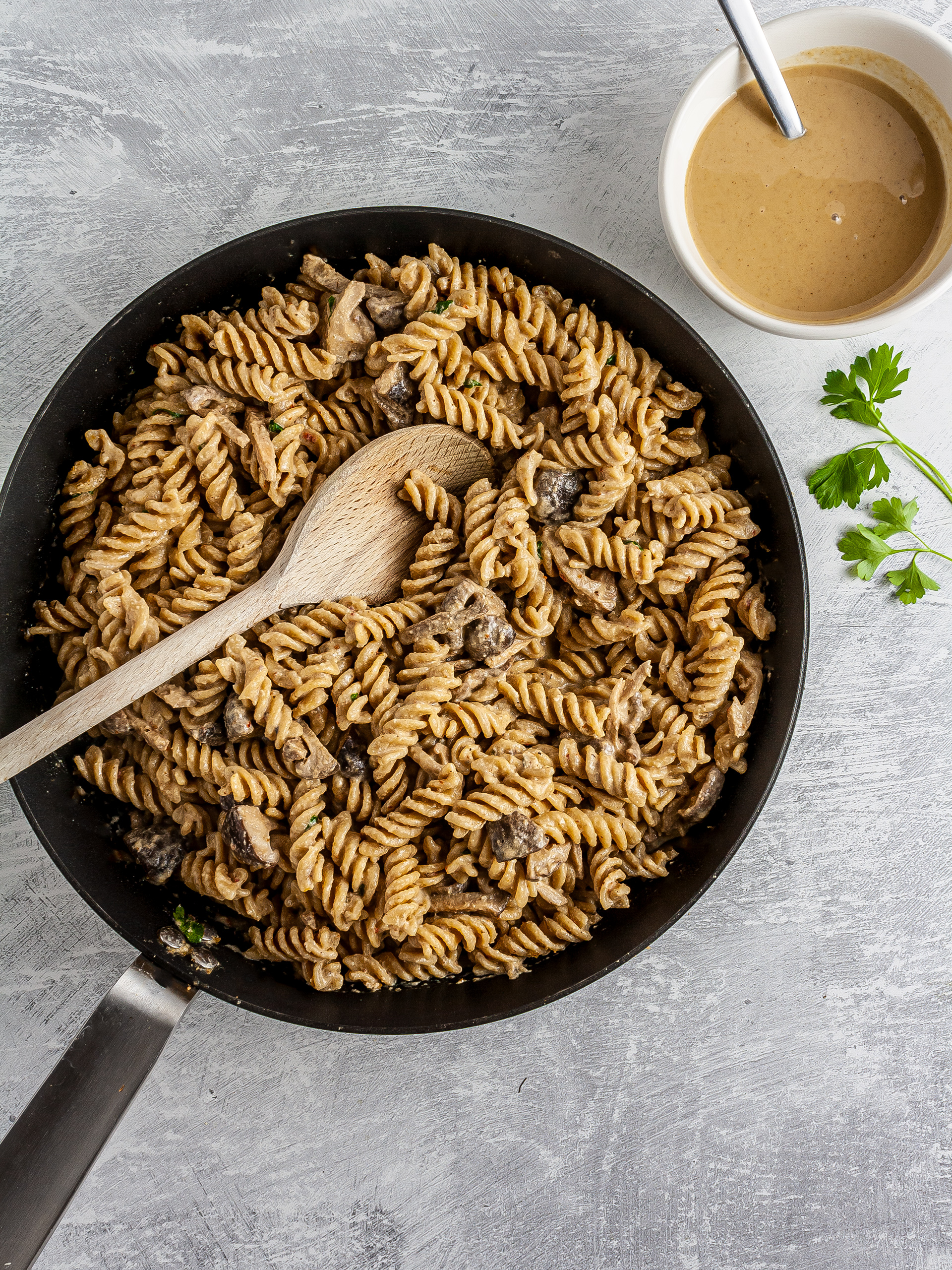 Pasta with tahini sauce in a skillet