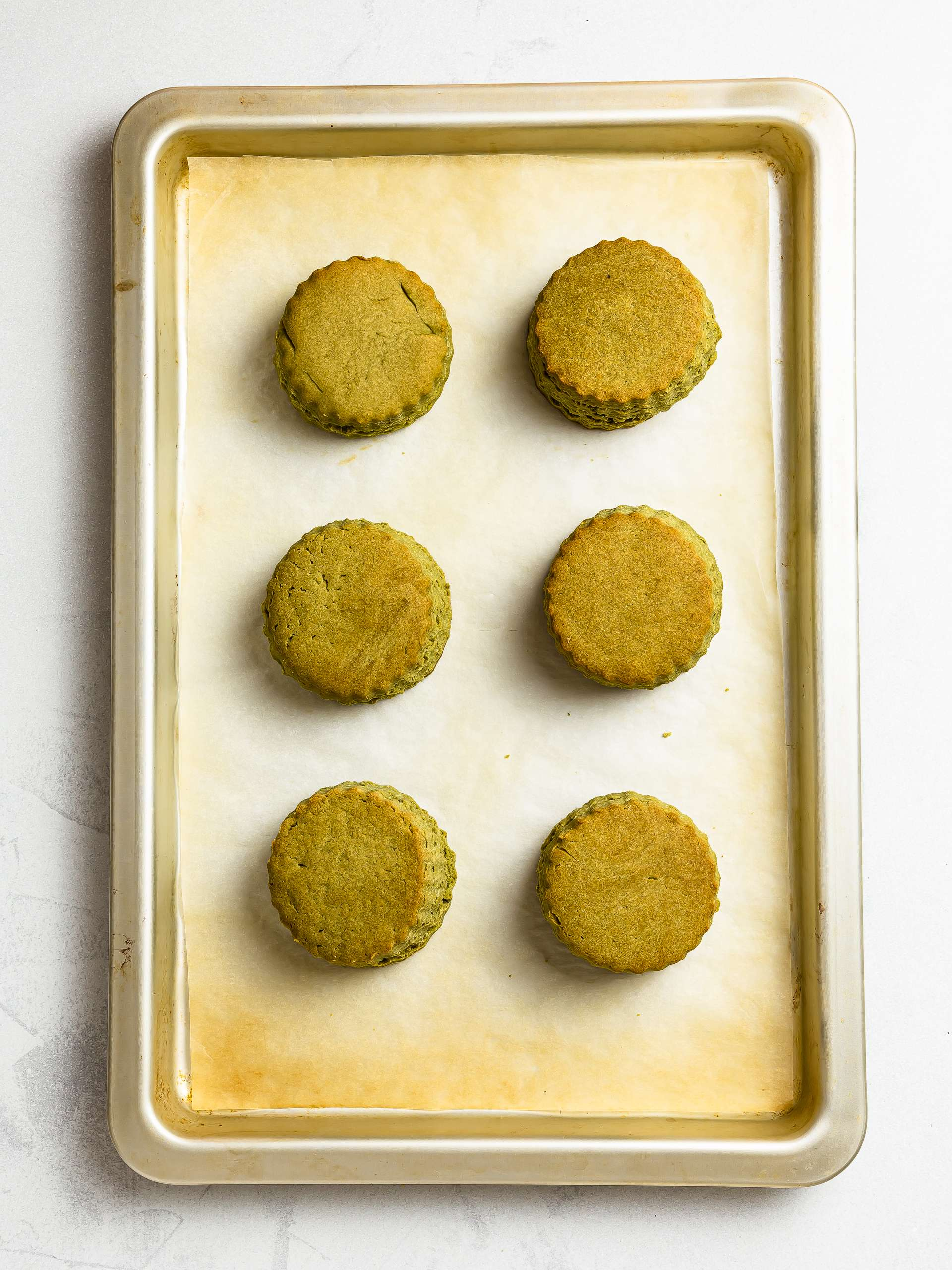 baked matcha scones on a tray