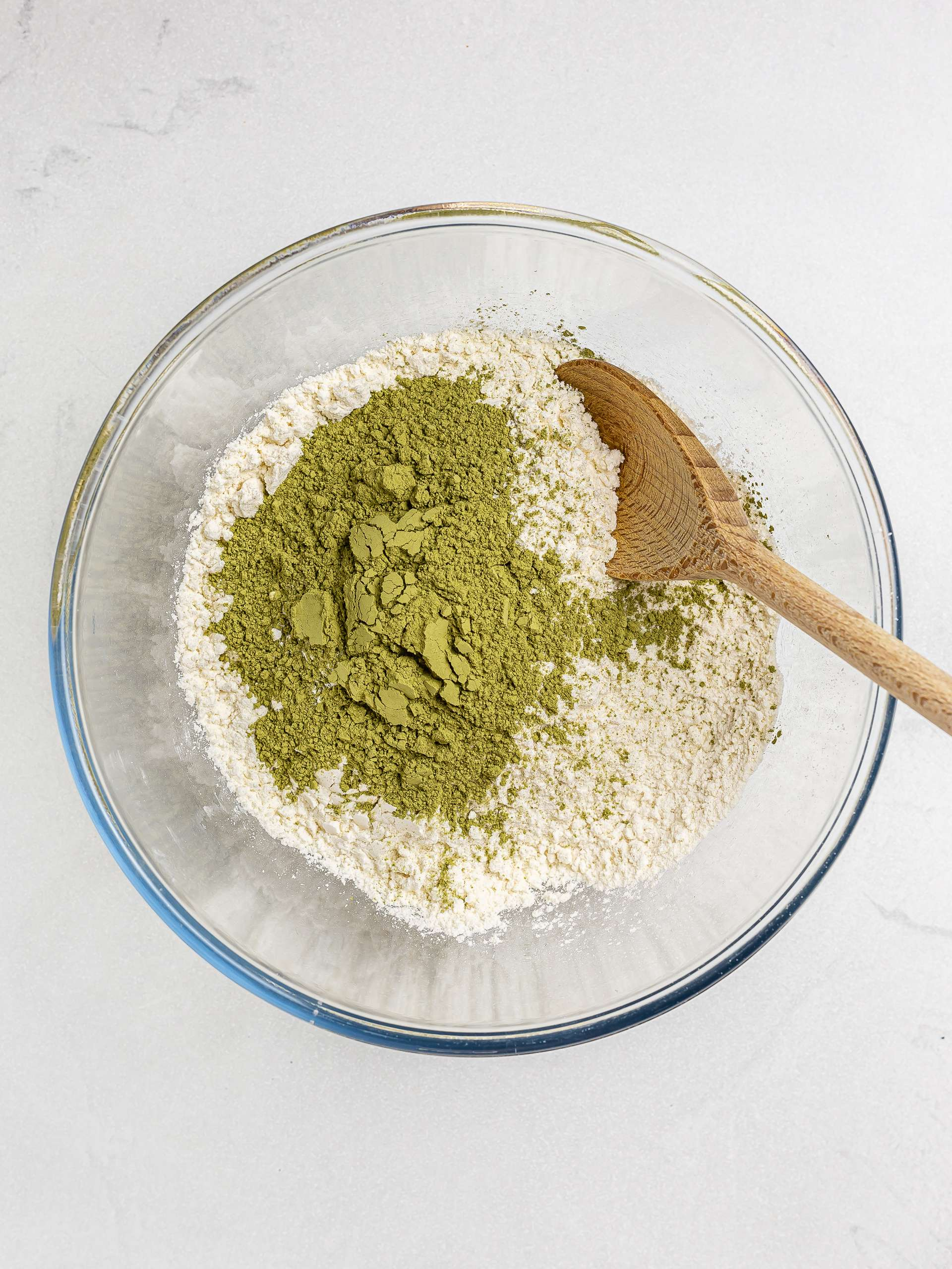 gluten-free flour with matcha powder in a bowl