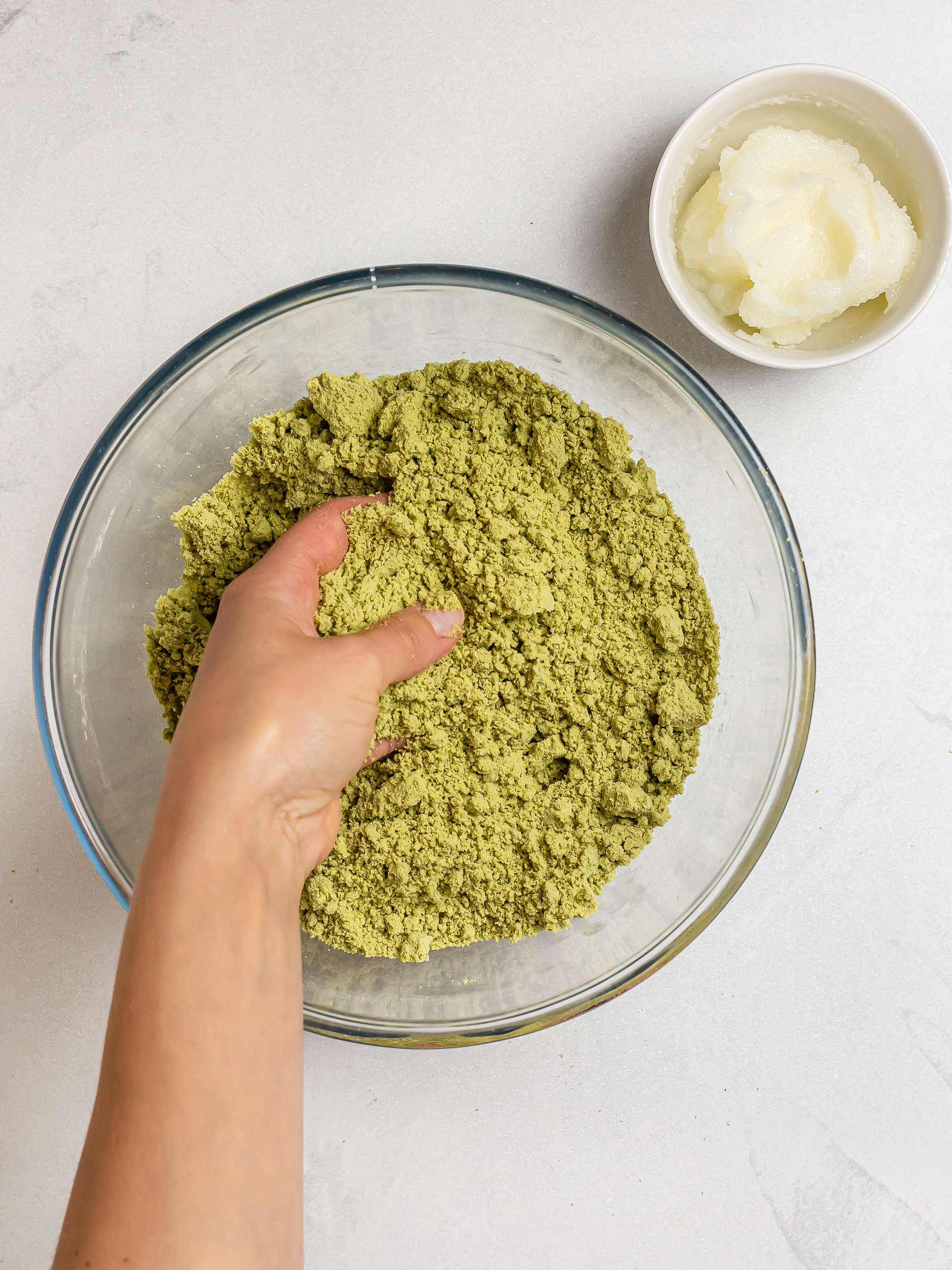 rubbing matcha scone dough with fingers