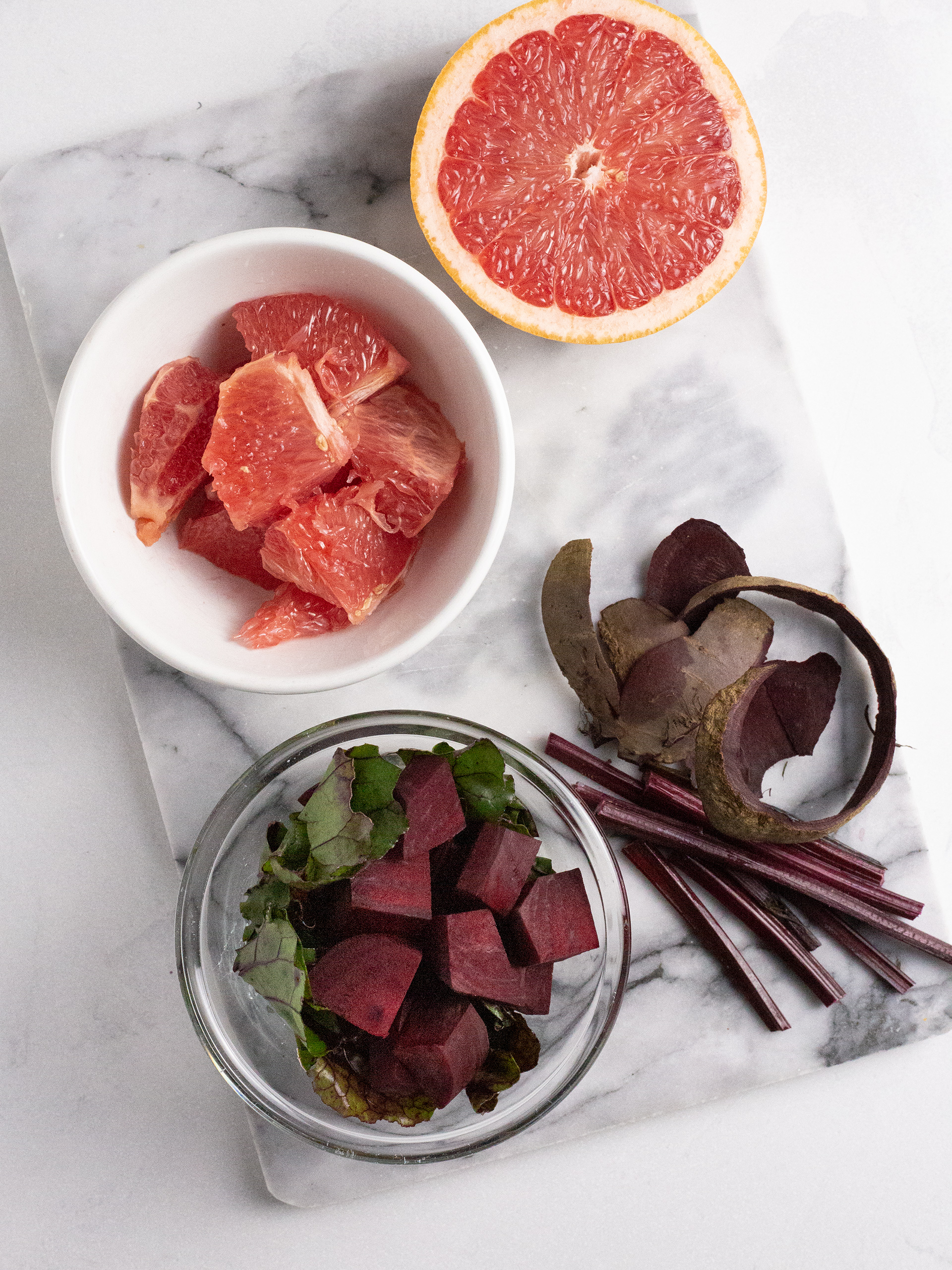 Peeled and sliced beets and grapefruit