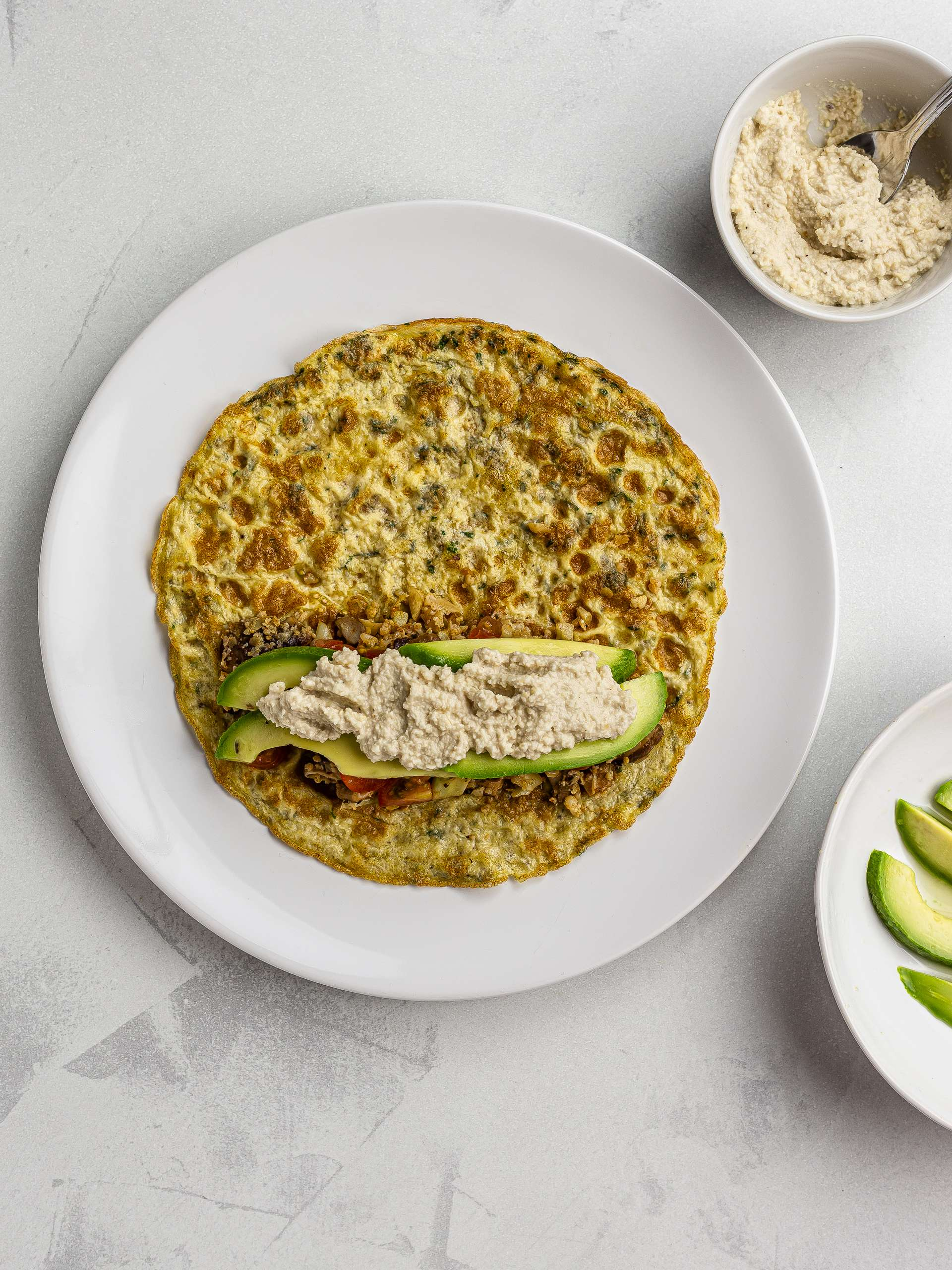 low-carb burrito with egg tortilla and avocado