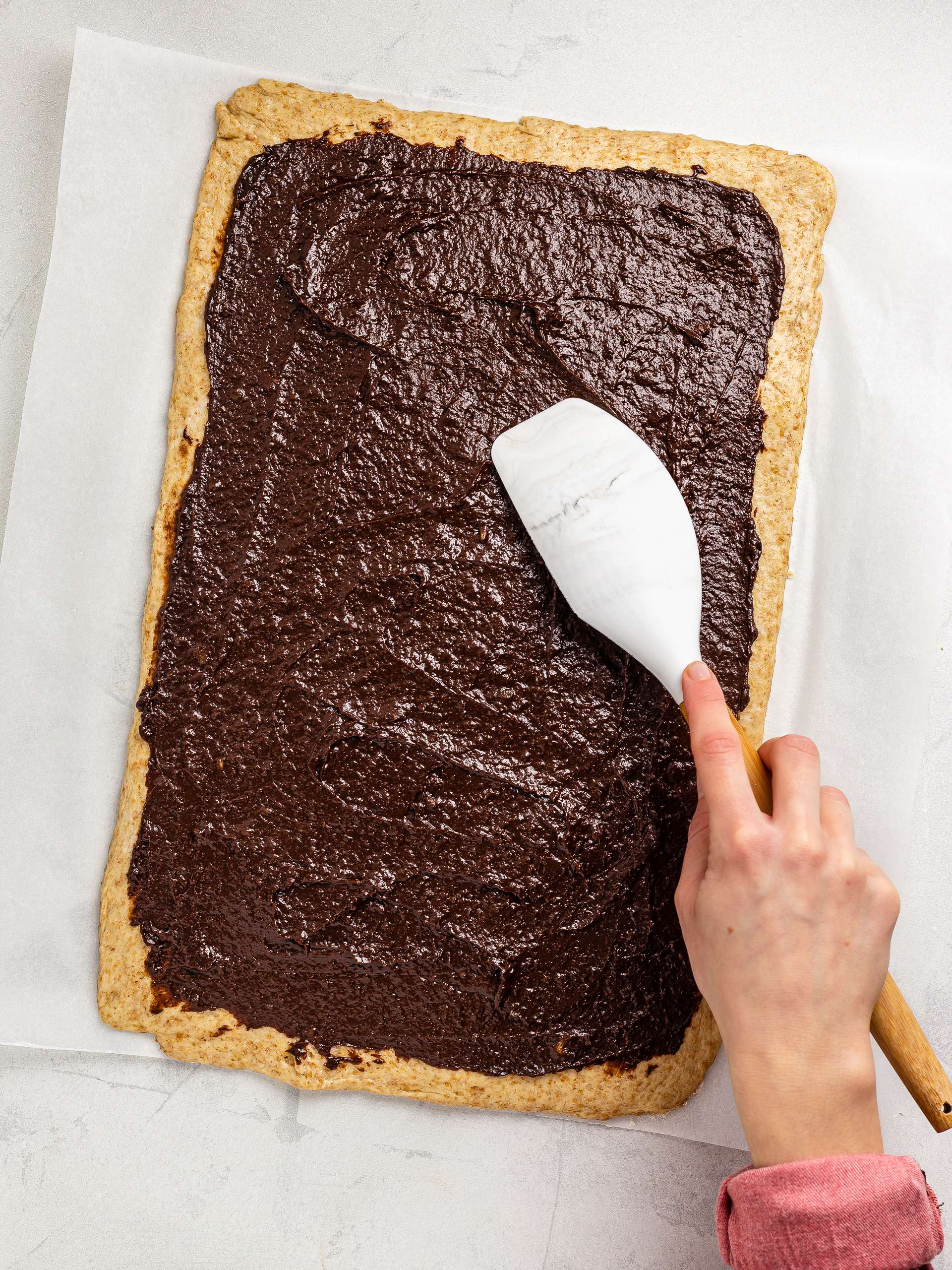 chocolate date filling spread over the dough base