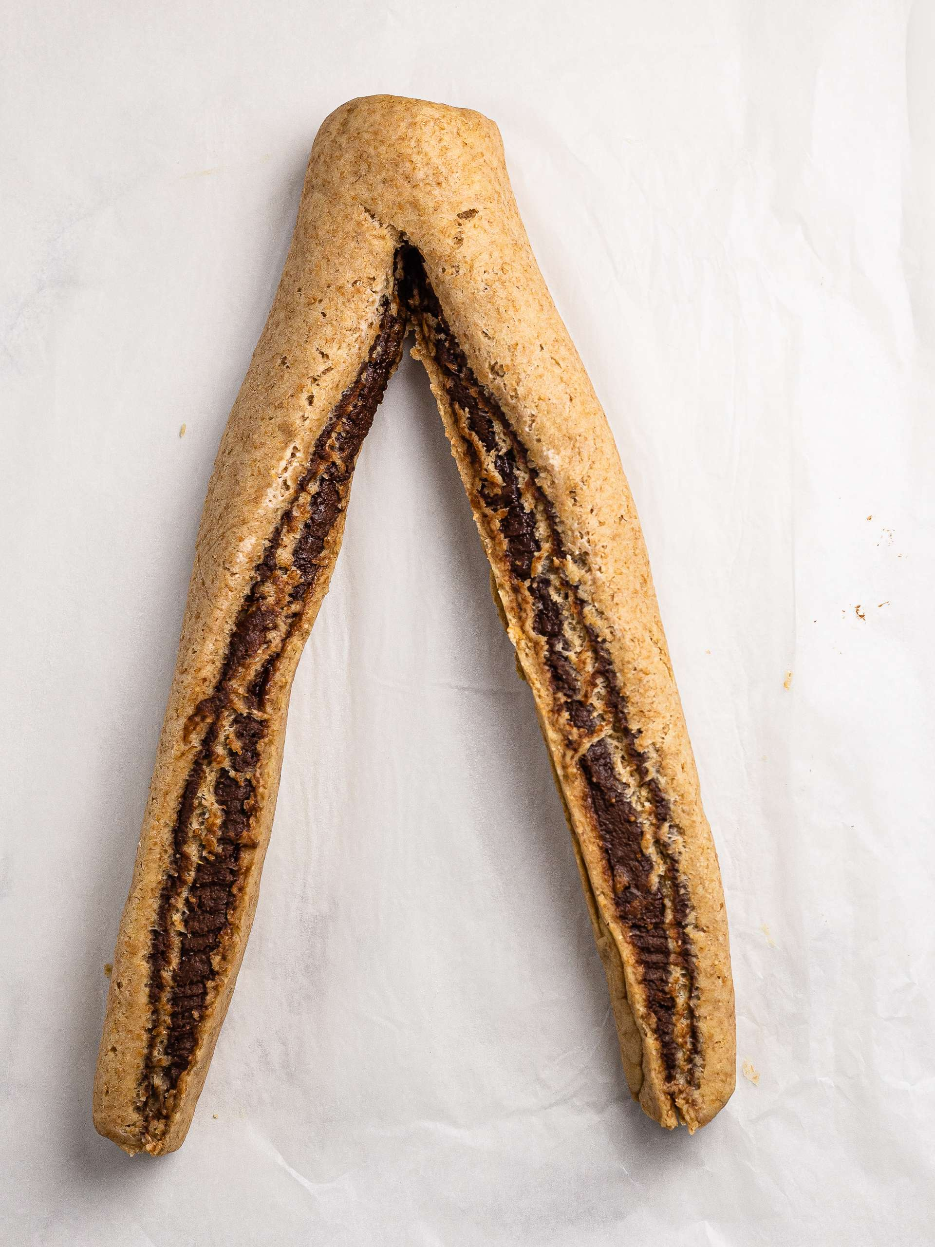 dough log sliced in half with the chocolate filling facing up