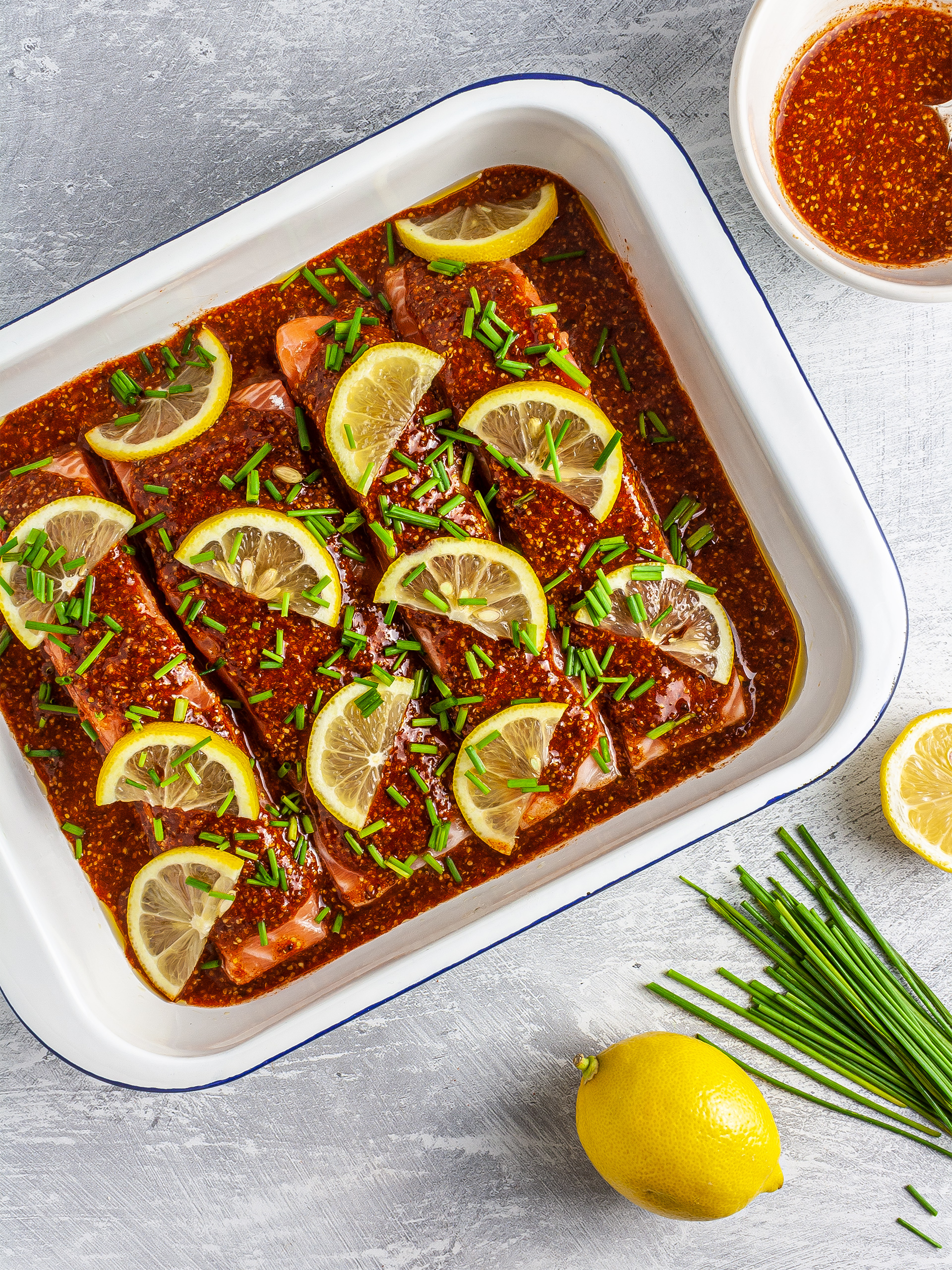Salmon fillets with honey mustard glaze, lemon, and chives