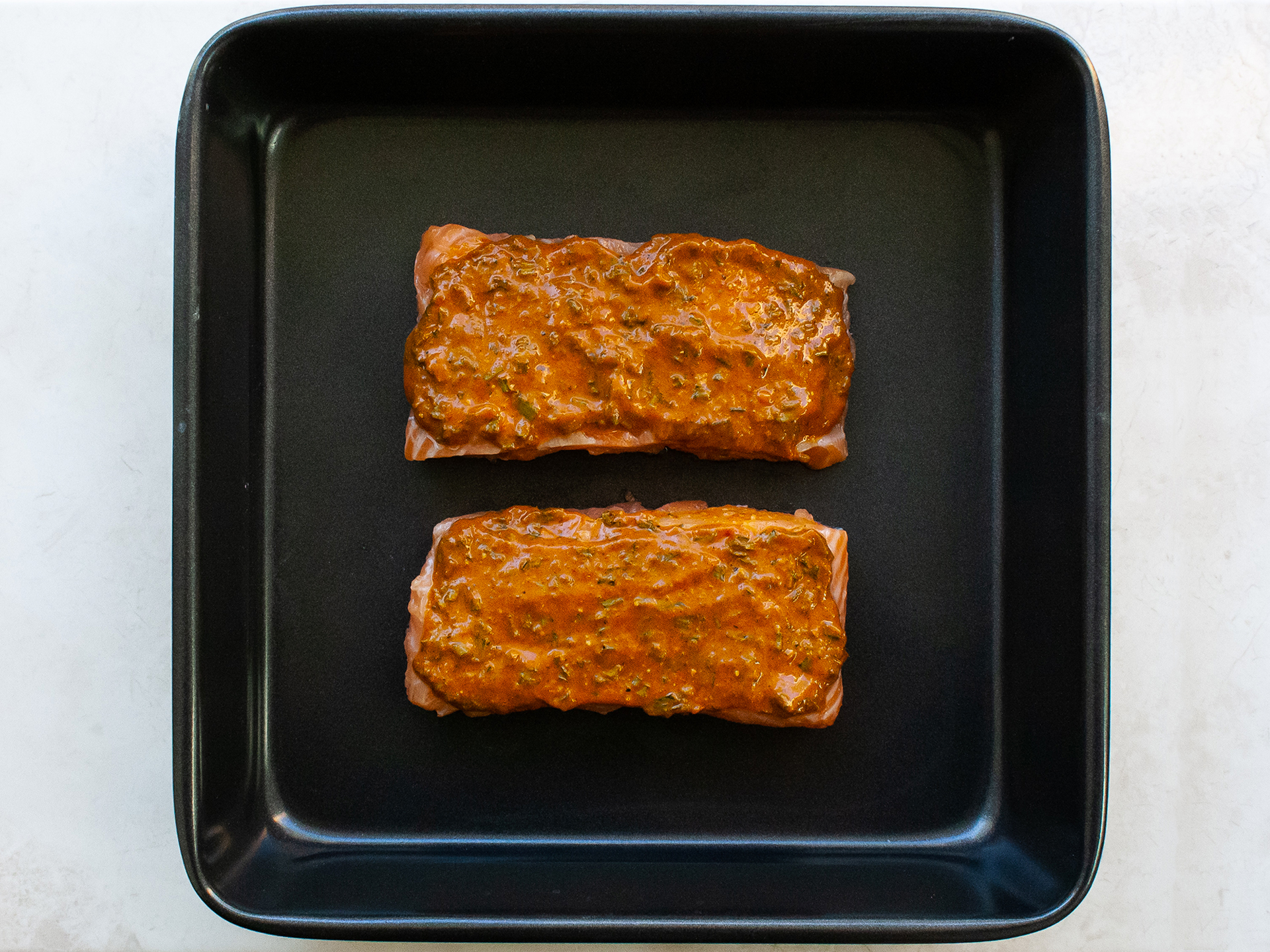 Salmon fillets with glaze spread over