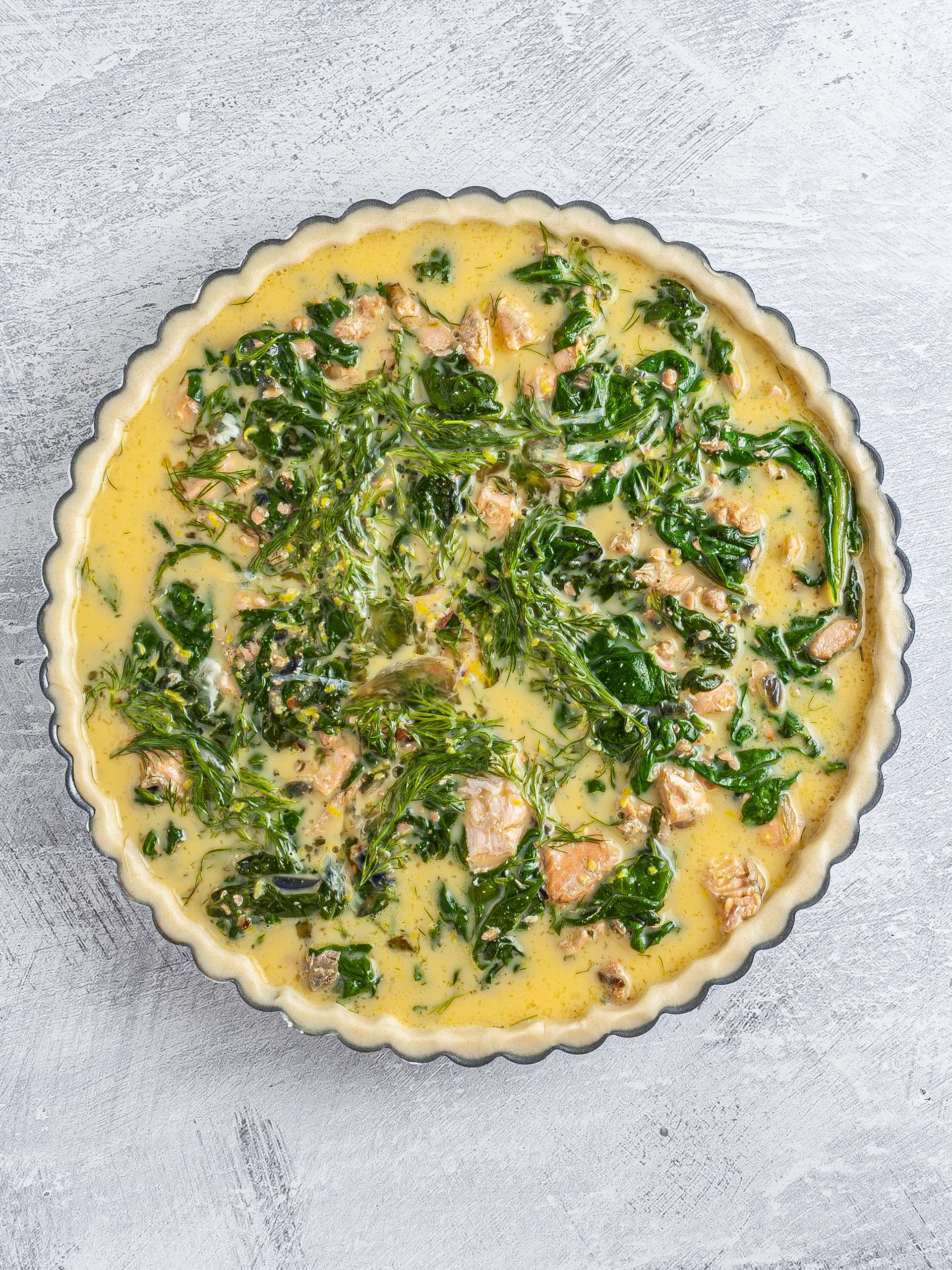 Salmon filling in the pie dish