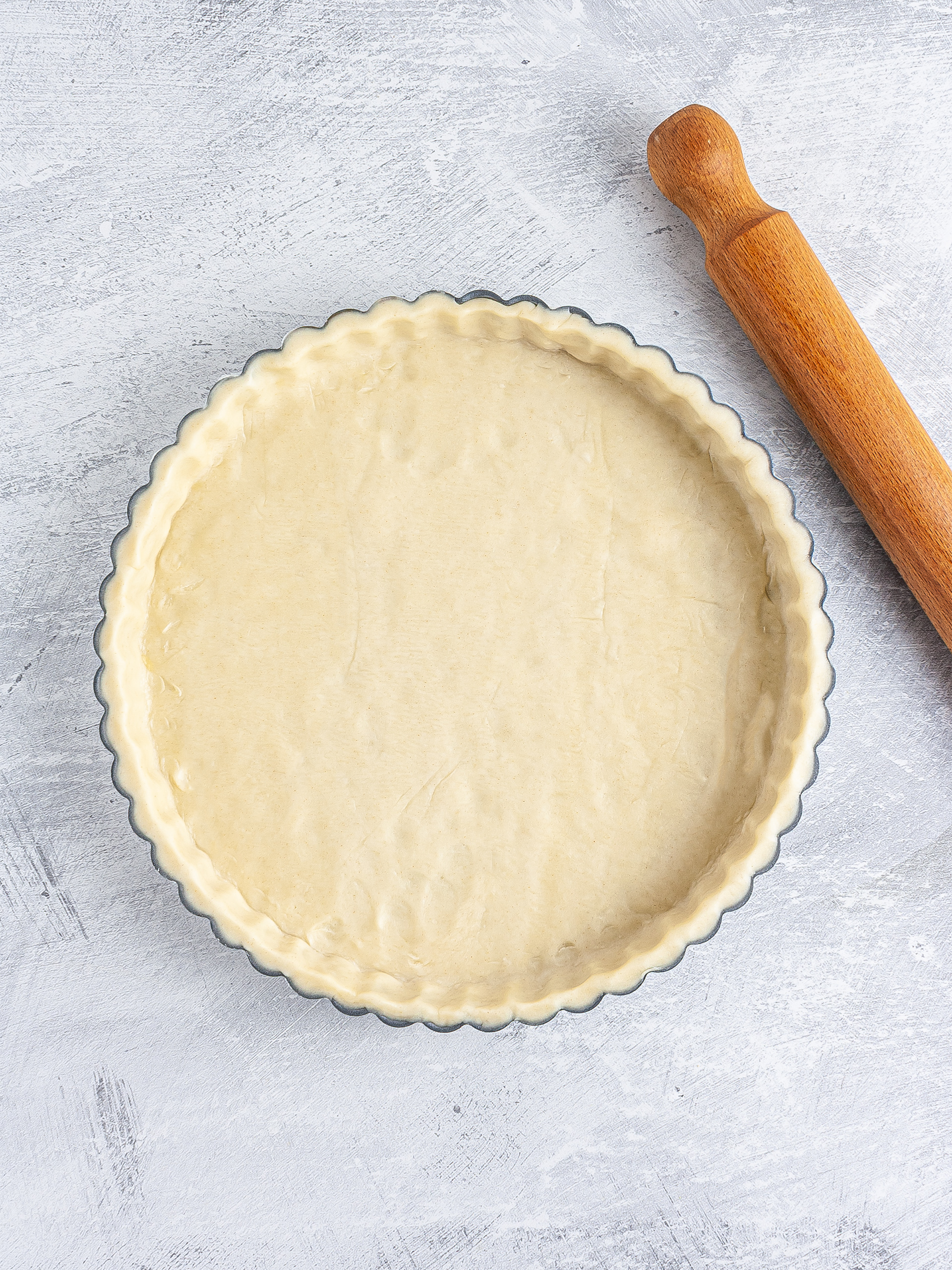 Shortcrust pastry in a pie dish