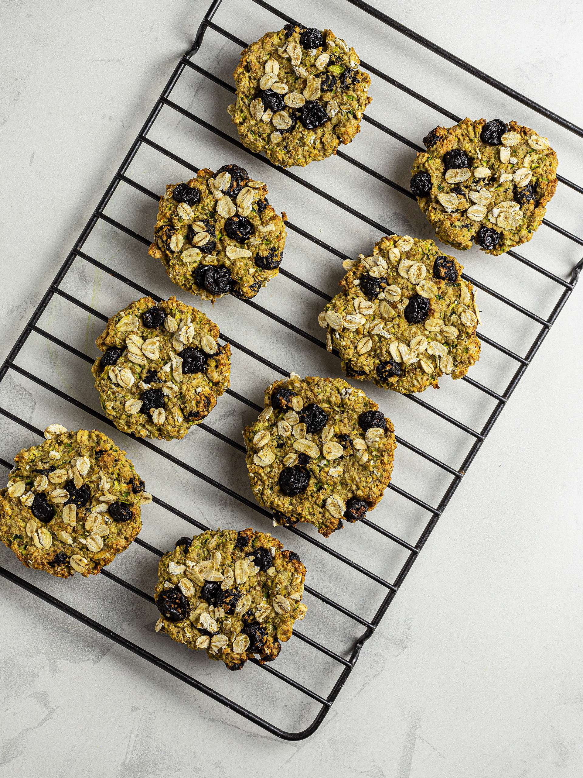 Baked zucchini cookies on a wire rack