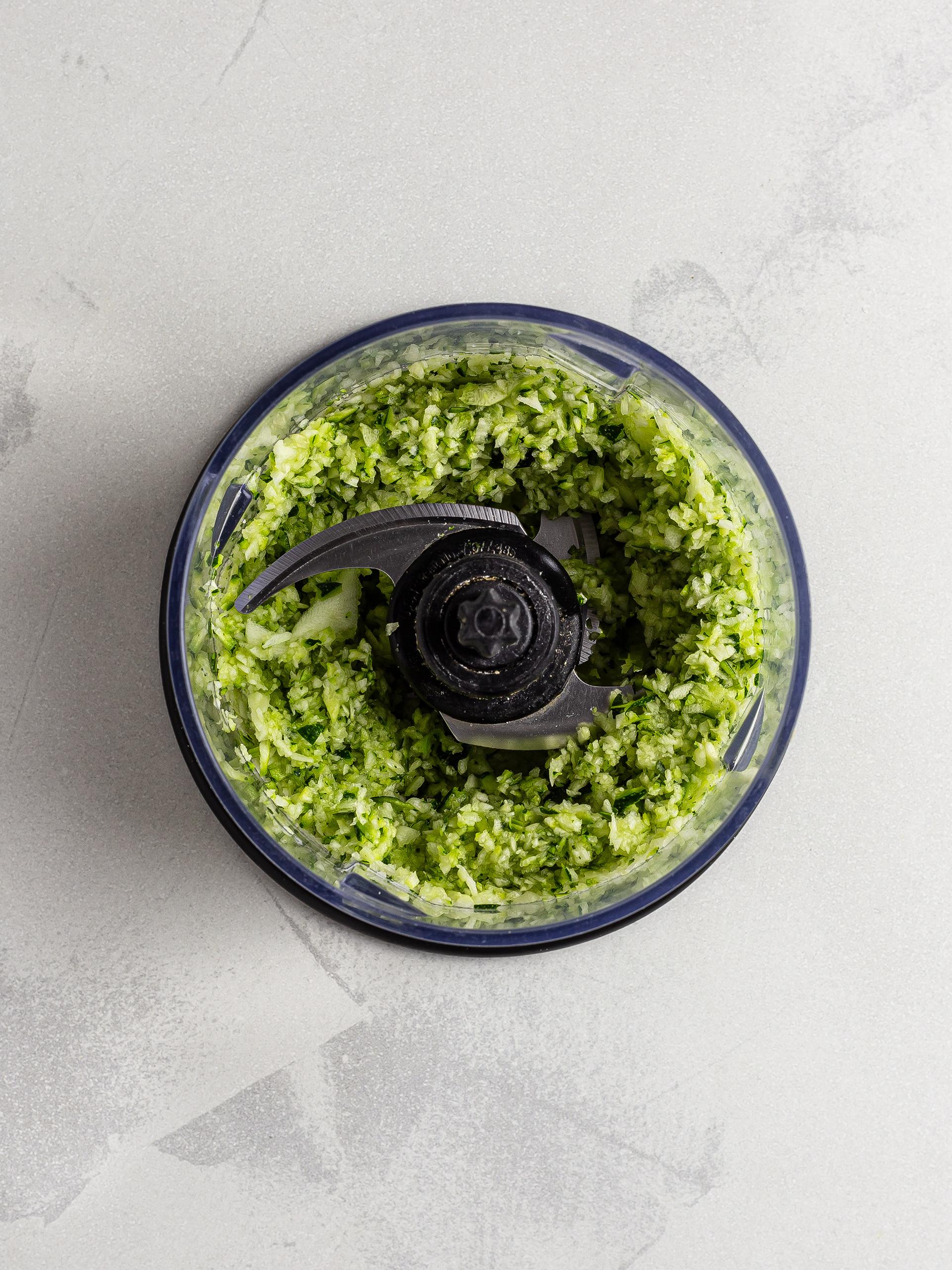 Grated zucchini in a food processor