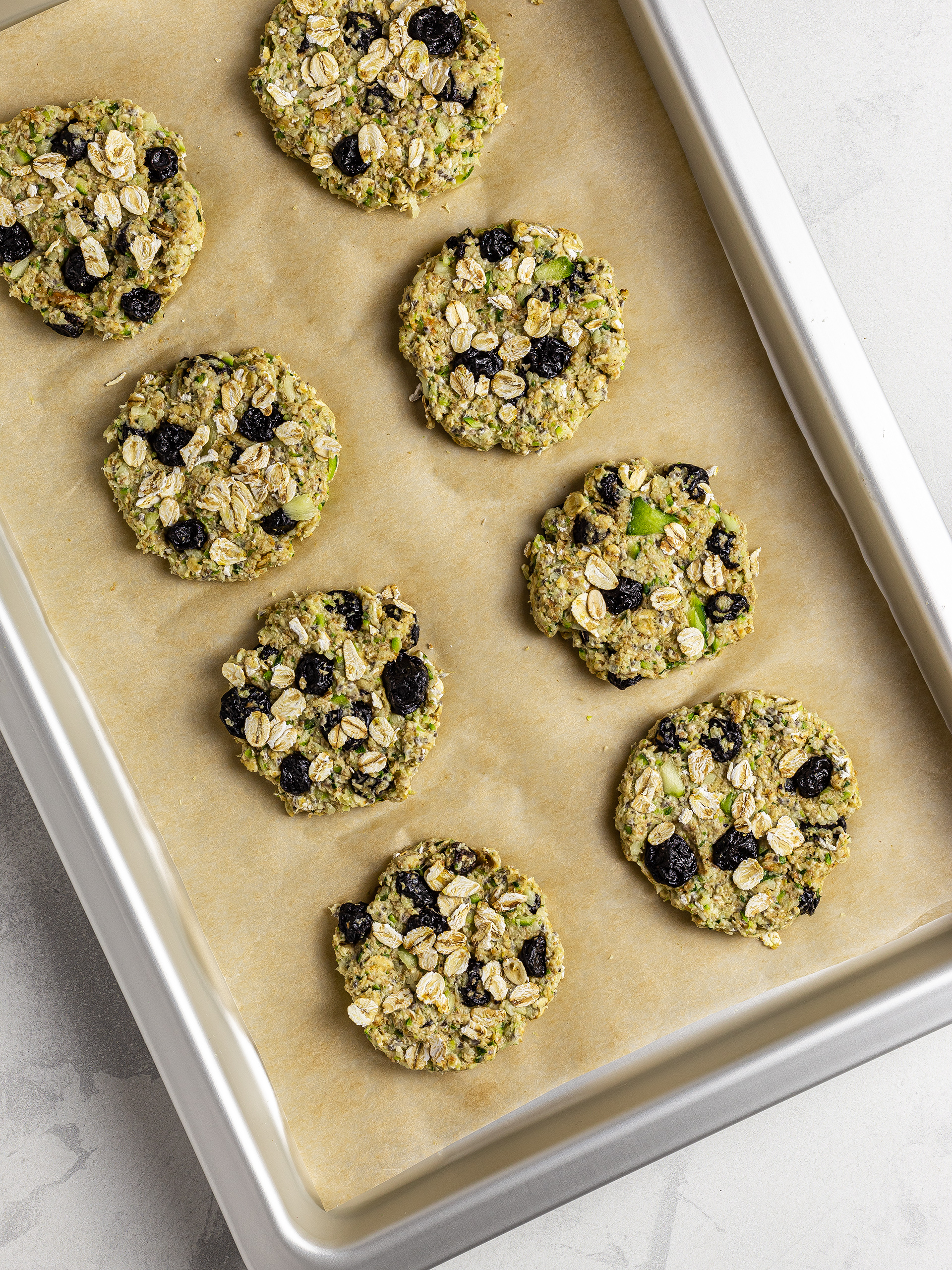 Shaped zucchini cookies on a baking tray