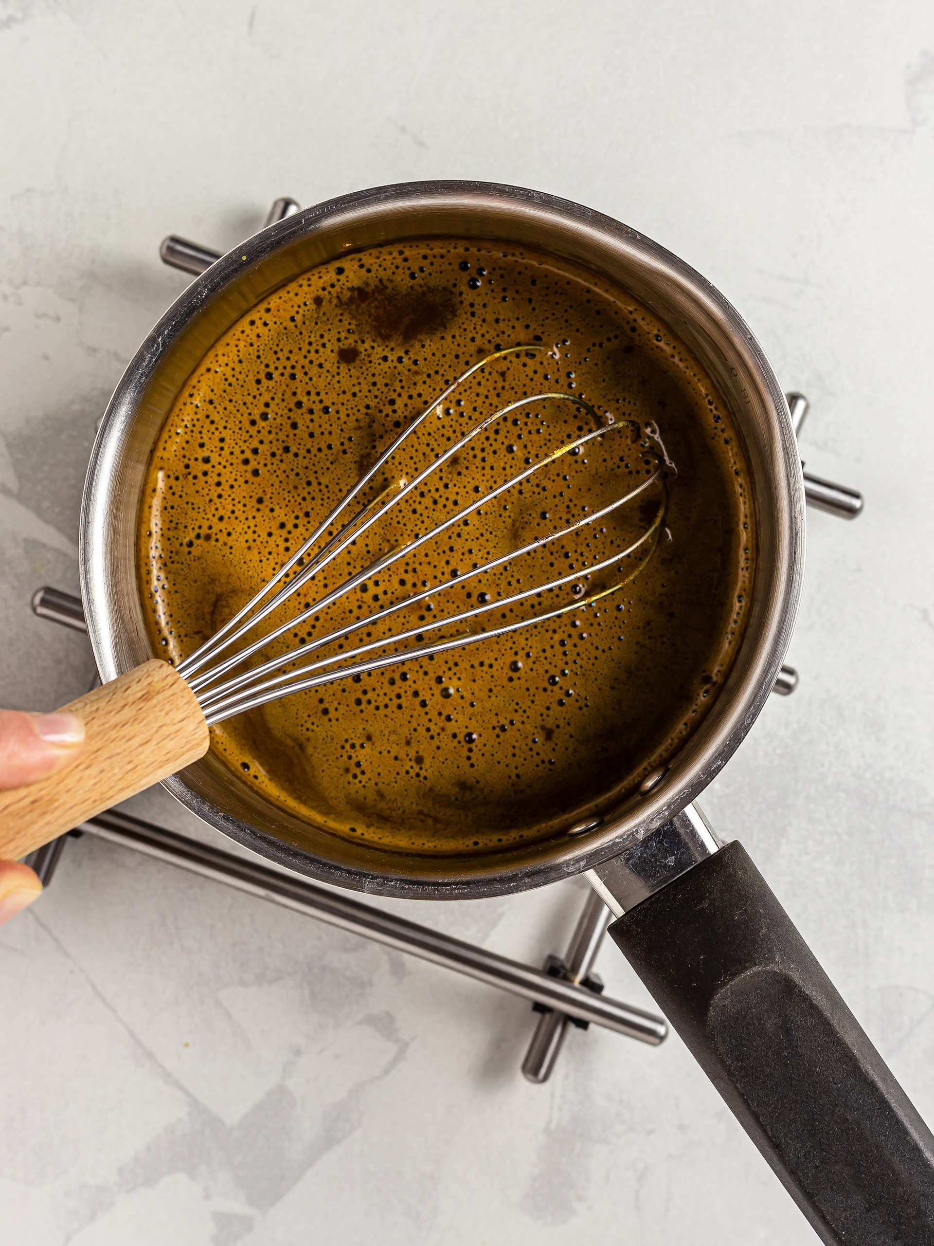 Whisked turmeric hot chocolate to make it foamy