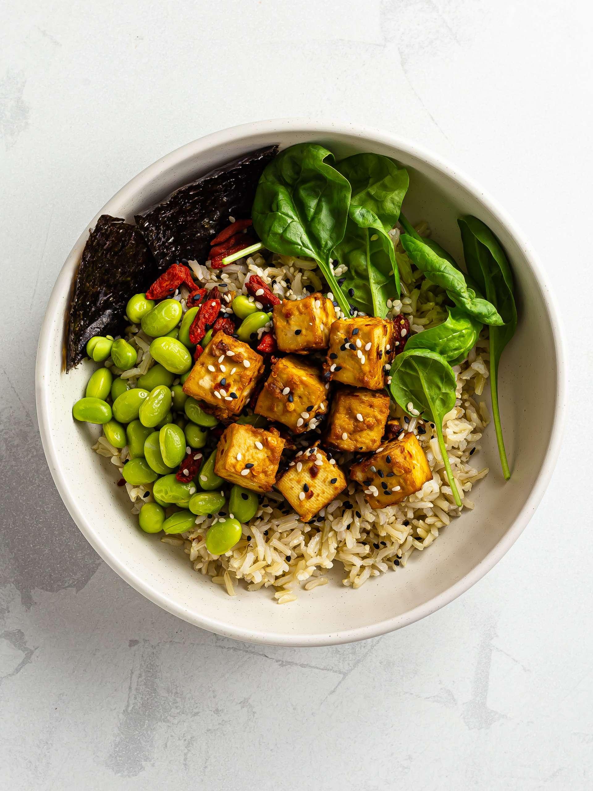 miso marinated tofu bowl with rice and edamame