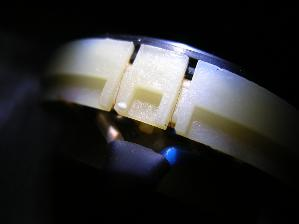 Voice coil entry on a HP2 driver (this area is protected by some kind of hardened white paste on...