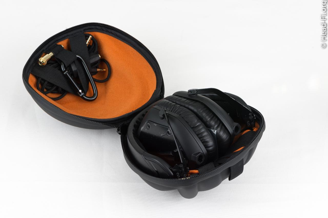 The V-MODA M-100 hard carrying case opened up, revealing the M-100 folded up. (In this photo,...