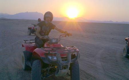 From Hurghada: 7-Hour Sunset Desert Safari by Quad Bike