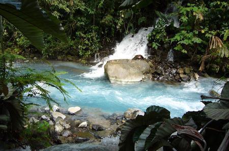 Blue Volcanic River Waterfalls and Hot Springs Mud Bath Adventure in Rincon de la Vieja from Tamarindo