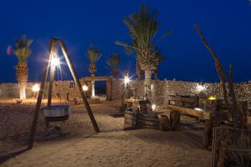Overnight Desert Camp Experience: Dinner, Emirati Activities and Vintage Land Rover Transport from Dubai
