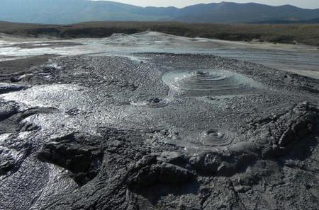 Muddy Volcanoes and Unirea Salt Mine Private Tour