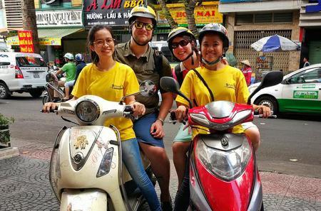 Ho Chi Minh City Night Tour by Motorbike Including Saigon Street Food
