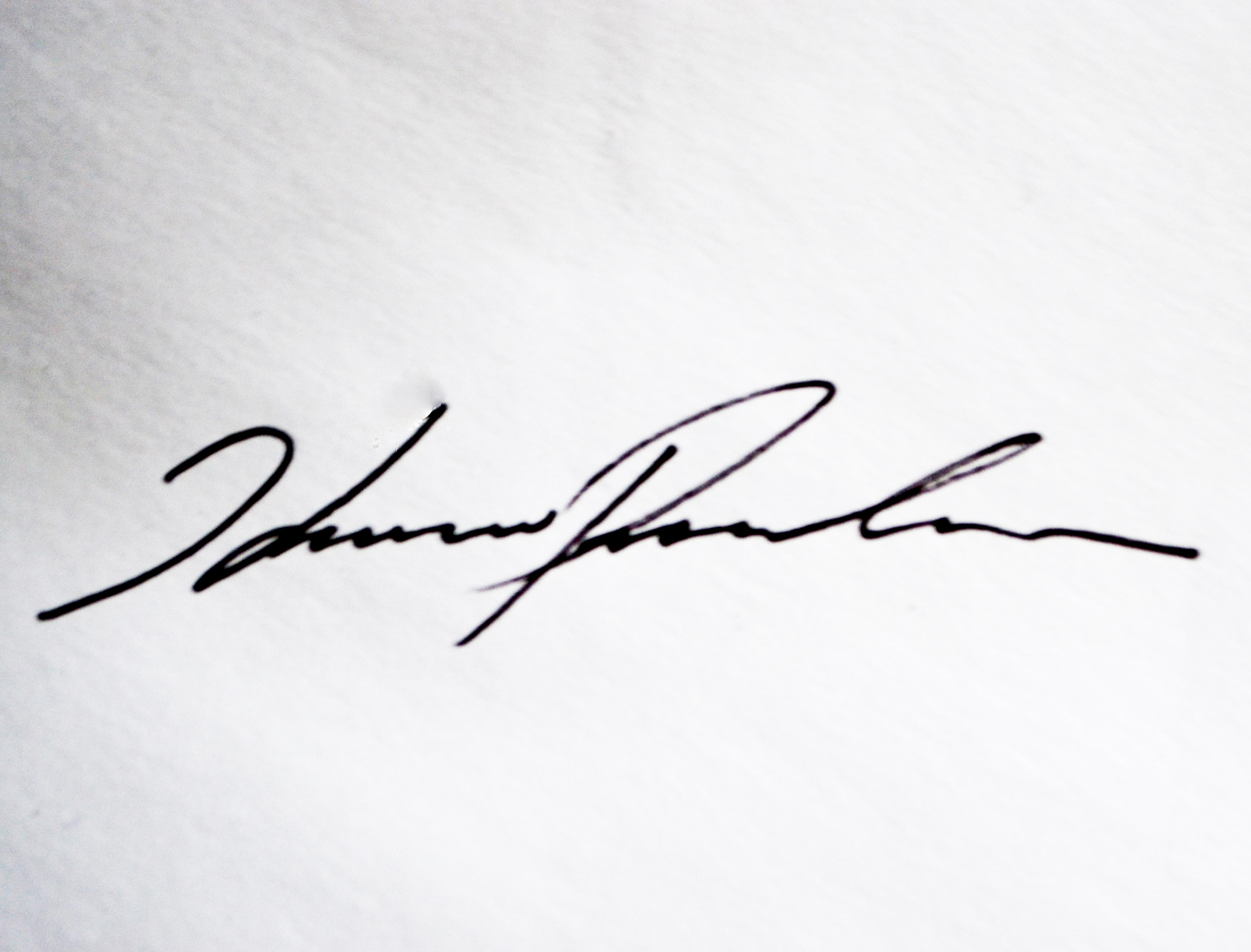 Karun Prakash's Signature