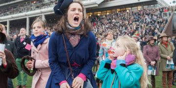 SWNS Pictures of the Year 2015 - One hundred of the most compelling images on the SWNS wire this year as chosen by our picture editors.(Left - right) Amelia Tinkler, 9, niece of jockey Andrew Tinkler, Sophie Burkin, 25, and Daisy Tinkler, 6, react whilst watching racing on Ladies Day at Cheltenham Festival. Cheltenham Racecourse, Cheltenham, England. March 11 2015.