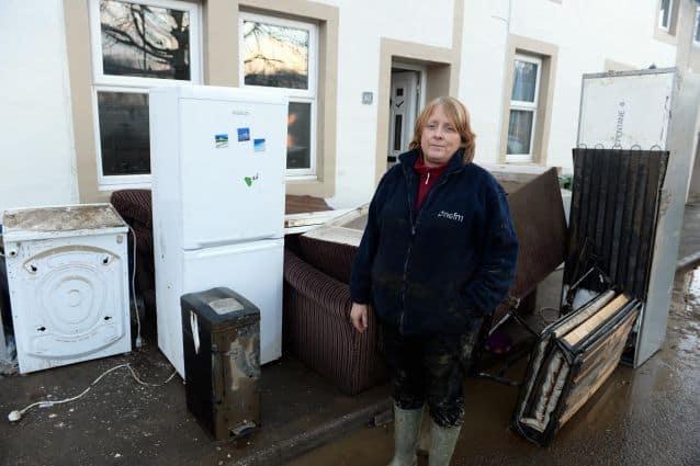 Cockermouth Flood 2015 - Sue Cashmore outisde her Gote Road home; Tuesday 8th December 2015: PAUL JOHNSON