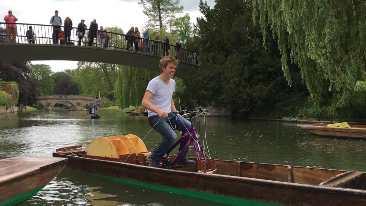Barnaby Walker, 22 on his pedal powered punt. See Masons copy MNPUNT: An engineering student has invented a new way of powering a traditional river punt - by pedal power. Barnaby Walker, 22, took up the challenge from his supervisor after trying to find new ways of powering a punt and came up with the 'puntcycle'. The Cambridge University student converted an unloved old punt into a sleek, two-wheeled speed machine - capable of leaving all other river-users in his wake. He decided to breathe new life into French Hen, a punt which was a year older than himself, and rescued it after being beached for three years.