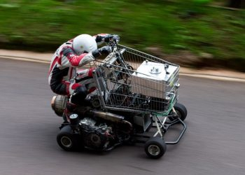 Matt Mckeown 55 drives the uphill course in his converted shopping trolley. Shelsley Walsh Hill Climb, Shelsley Walsh, Worcestershire. September 04, 2016.  This is the bizarre moment a petrol head competed in a motorcycle road race - in a jet-powered SHOPPING TROLLEY. See NTI story NTITROLLEY.  Madcap Matt McKeown, 55, of Plymouth, Devon, build his wacky racer - which has a top speed of 80mph - from an abandoned cart he found in a ditch.  He bolted on brakes, go-kart wheels and a 150 horsepower engine from a Chinook helicopter before taking it for time trials.  Matt first set a record of 45.5mph then made several tweaks and broke his own record by reaching 71.4mph at Elvington Airfield in North Yorks.  On Sunday (4/9) Matt wowed the crowds when he competed in the Shelsley Walsh Hill climb in Worcestershire.  Despite crawling up the 1,000 yard course - which hits a steep 1:7 incline at its peak - Matt wasn't last to finish and managed to beat a number of other conventional bikes.