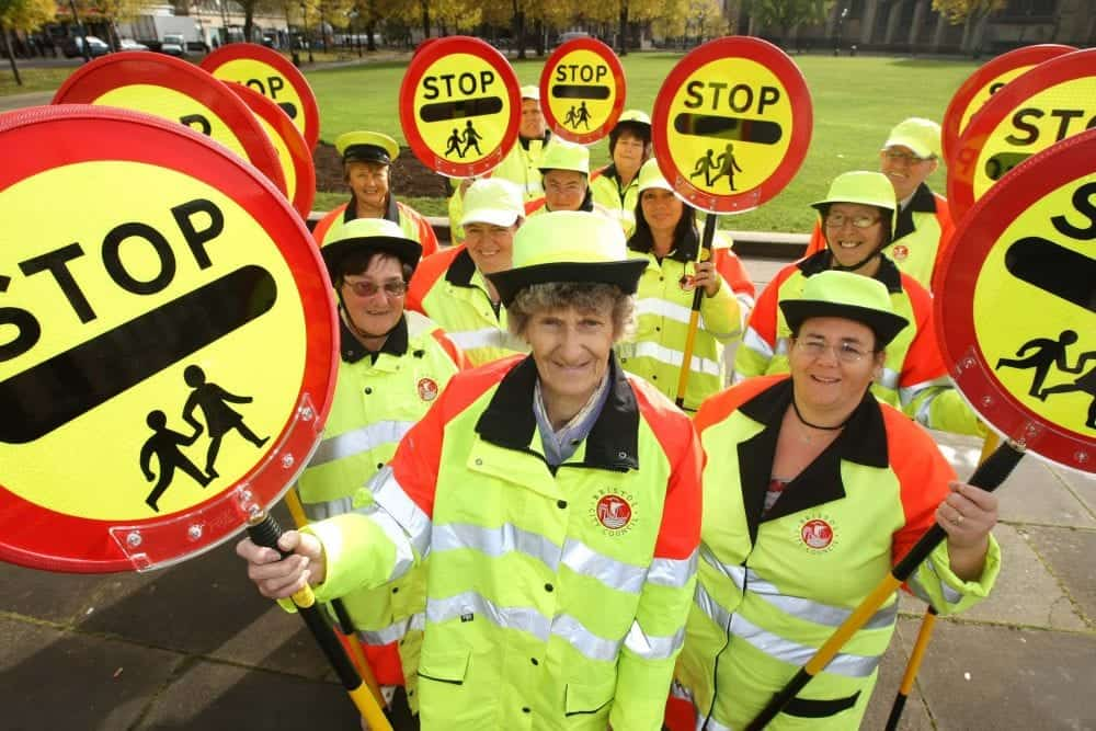 Stock photo of Bristol's school crossing patrol people. See SWNS story SWCROSS; A council could become the first in Britain to scrap ALL lollipop ladies and men - as the popular crossing guards face the axe across the country. Cash-strapped Bristol City Council plans to ditch the patrol staff at 80 schools in a bid to slash £360,000 off its budget. But the authority has been warned by a furious school governor that axing all 67 lollipop people will lead to more children being hurt in accidents on busy city roads. In its impact report, the council even admits cutting the school patrols will impact on the safety of children - with each child's life being priced at £4,500.