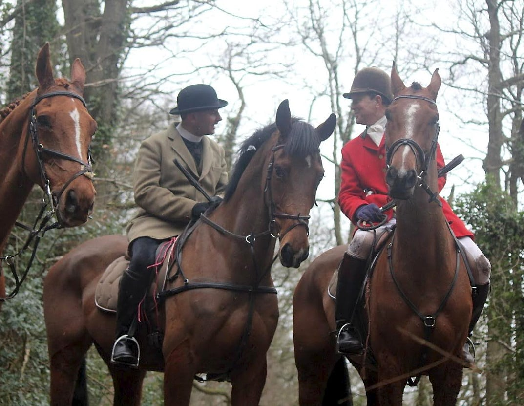 Rev Neil Patterson in a beige hunting jacket (left) with Major Patrick Darling, former High Sheriff of Herefordshire on February 20, 2016 when the Three Counties Hunt Saboteurs claim he was at a meet of South Herefordshire Hunt in Brockhampton. See SWNS story SWHUNT; A campaign has been launched calling for a vicar to be sacked after footage emerged which appears to show him at a hunt meet - at his parish CHURCH. The Rev Neil Patterson, 36, has been accused of lacking Christian values after photos surfaced of him on a horse with the notorious South Herefordshire Hunt. The Hunt is being investigated for animal cruelty over footage was released in June which appears to show live fox cubs being thrown to a pack of hounds to savage. Five people have been arrested so far this summer as part of the inquiry.
