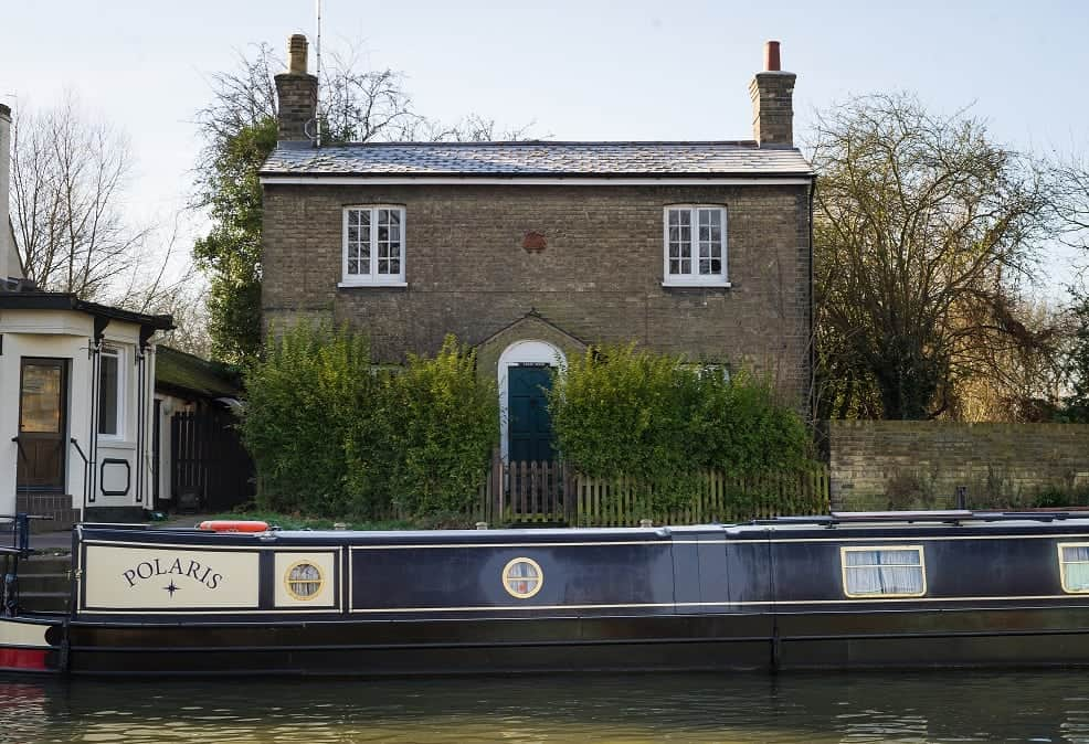 Ferry House situated on the bank of the river cam in Cambridge next to the Fort st George pub and close to the Mihelin star restaurant Midsummer house. See SWNS copy SWCOUNCIL:A riverside home with a Michelin-starred restaurant on its doorstep is set to become one of the UK's most expensive COUNCIL HOUSES after it was put on the market for £750,000.Ferry House is a three-bedroom 'doer upper', which sits on the bank of the River Cam in Cambridge. It is in heart of the historic city centre and within half-a-mile of a mixture of ancient and modern buildings, colleges and shops.