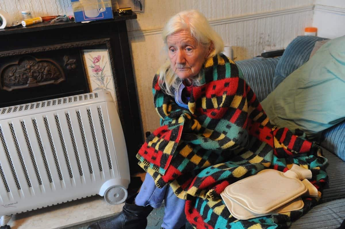 "Pictured is Shirley Walsh at her home on Kathleen Road, Hull, where she is forced to use electric heaters, hot water bottles and blankets to keep warm. See Ross Parry story RPYCOLD; A 74-year-old widow has been left ""freezing"" in her Hull home for months after her gas was cut off leaving her with no central heating or hot water. Shirley Walsh, from east Hull, takes SIX hot water bottles to bed with her at night in a desperate bid to keep warm. The retired seamstress says her supply was cut off in September after workmen found a leak in pipes under her front garden in Kathleen Street, where she has lived for 43 years. But because the leak was on her property, Northern Gas Networks told her she would have to pay for the repair, a cost the pensioner says she can't afford."