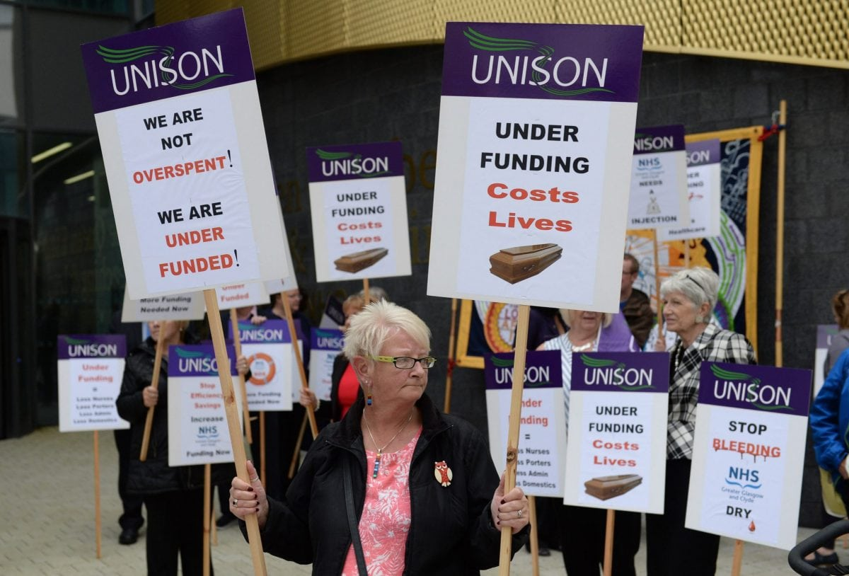 Members of Unison and other NHS campaigners protest outside The Queen Elizabeth Hospital ahead of a meeting of NHS Greater Glasgow and Clyde annual board meeting. August 4, 2016. The protesters are blaming the authority for a number of cuts to services.