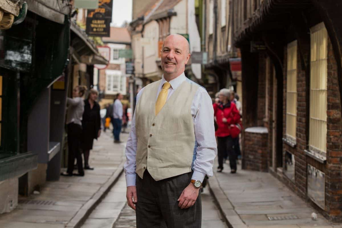 David Leckie, 58, of York, on York's iconic Shambles street. Mr. Leckie, a therapist and mediator, has launched the Divorce Hotel service, where couples can come to a harmonious settlement over the course of a weekend. April 17, 2017.