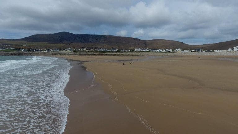 Villagers are delighted after this entire beach that was washed away 33 years ago has re-appeared - virtually overnight thanks to a freak tide. See SWNS story SWBEACH; The stunning beach near the Irish village of Dooagh on Achill Island vanished in Spring storms of 1984 after waves washed away all the sand. With nothing more than rock pools left behind, almost all the villages' hotels, guesthouses and cafes shut down. But miraculously thanks to a freak tide, hundreds of thousands of tons of sand were dumped on the beach over ten days in April, re-creating a stunning 300m long beach.