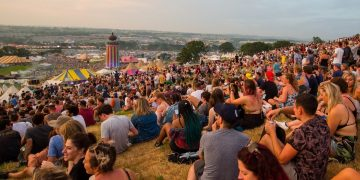 Revelers enjoy the sunset at Glastonbury Festival at Worthy Farm, Somerset, as the hottest day of the year comes to an end. June 21 2017.