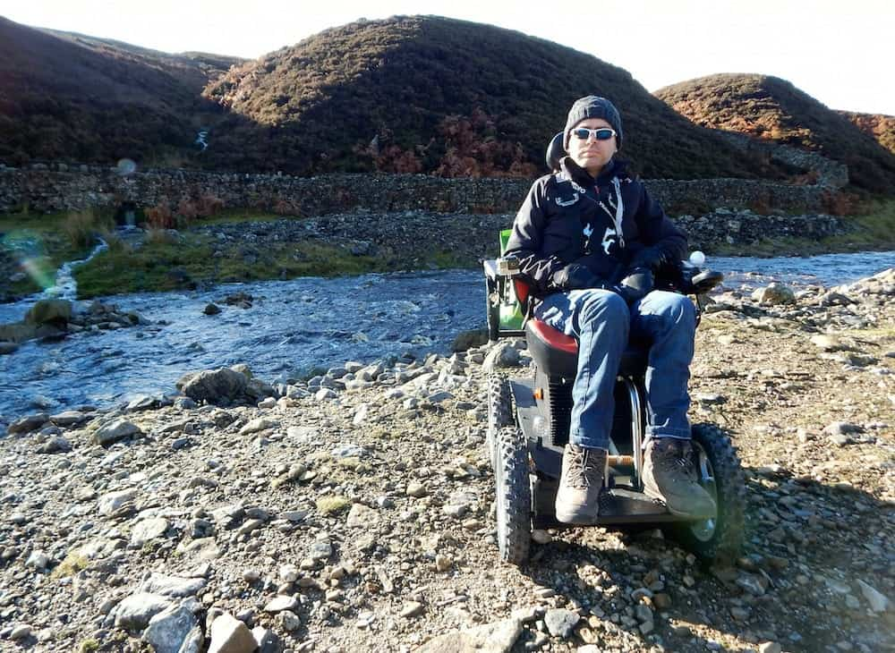 Jason Liversidge from Hull, East Yorks preparing for his latest challenge.  He says motor neurone disease is killing him, but wheelchair-bound Jason Liversidge will not let the condition stop him tackling mountains and other challenges.  See ROSS PARRY story RPYCLIMB.  With the help of his all-terrain 4x4 wheelchair, the Holderness dad of two aims to climb the highest mountain in Wales, Mount Snowdon.  Mr Liversidge, 41, is taking on the challenge in a bid to raise £5,000 for Marie Curie Nurses and the Dove House Hospice, Hull.  After being diagnosed with the muscle-wasting disease in 2013, Mr Liversidge, 41, from Rise, near Skirlaugh, has lost the ability to move.  But the self-confessed adrenaline junkie has not let his condition get in the way of his passion for excitement.  He has taken on the longest zip line in Europe at speeds in excess of 100mph, parasailed in Turkey and driven at Silverstone in a Formula One-style racing car.  After an online funding campaign to acquire a 4x4 wheelchair, he is now preparing to take on Mt Snowdon on Tuesday, July 18.